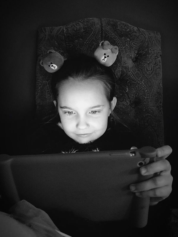 One Person Indoors  Real People Childhood Lifestyles Technology Wireless Technology Elementary Age Portrait Close-up Ipad Girls Holding Sitting Looking Home Interior Human Hand Young Adult People Black And White Friday Black And White Light IPad Time Girl