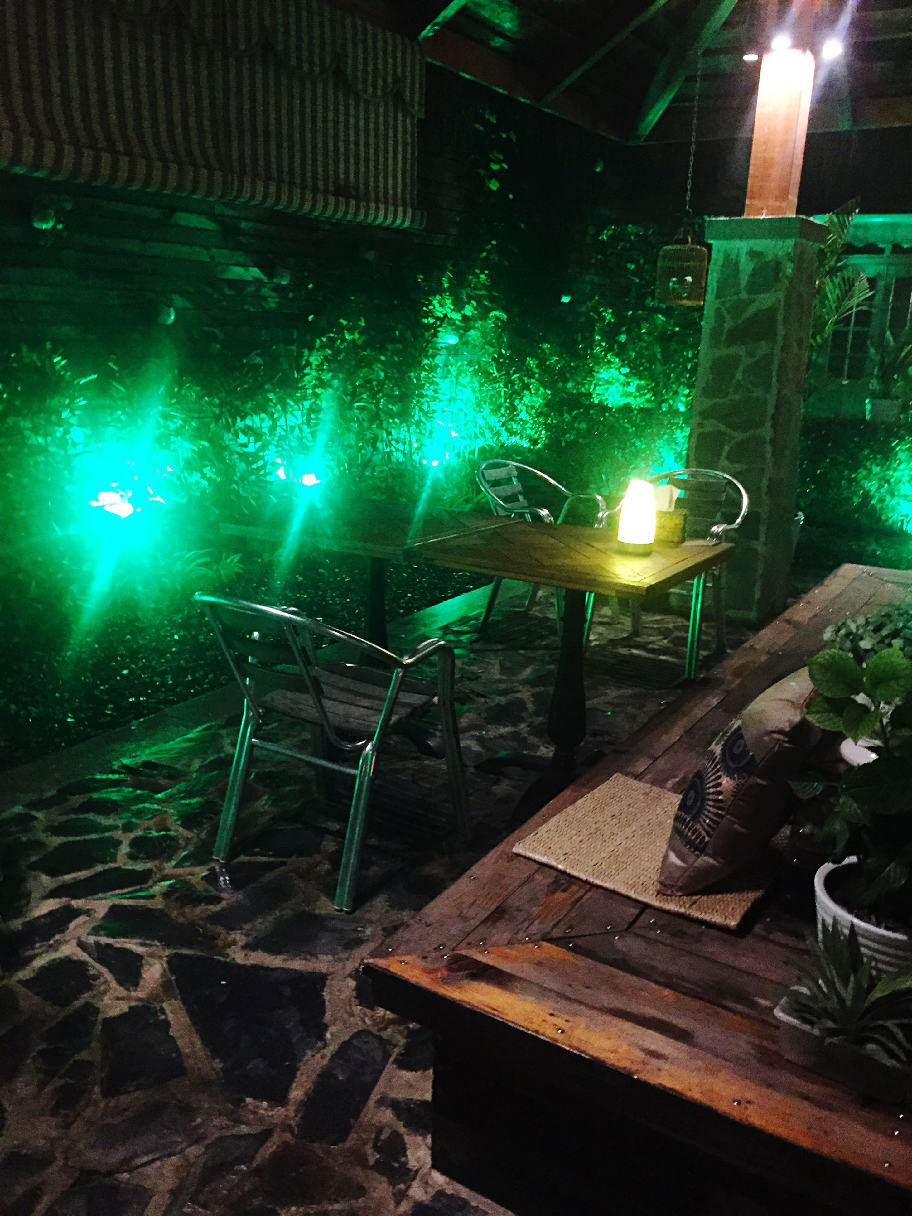 illuminated, night, lighting equipment, indoors, glowing, light - natural phenomenon, electric light, electricity, chair, electric lamp, no people, absence, table, lit, candle, hanging, wood - material, light, light beam, dark