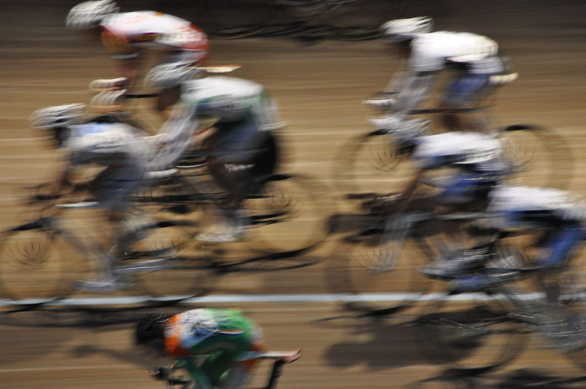 Bicycles Blurred Motion Blurry Competition Competitions Contest Cycle Race Cycle Racing Cycling Sport Cycling Track Group Of People Match Motion Motion Blur Movement Race Racing Racing Bicycles Speed Sports Sports Photography Sprinting Velodrome