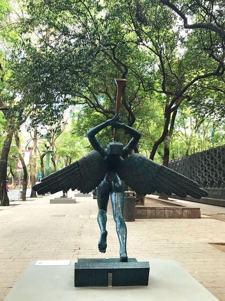 In my city, Dali sculpture on the street. Statue Art And Craft Sculpture Human Representation Male Likeness Craft Tree Day Built Structure Outdoors Architecture No People Mexico City My City Paseo De La Reforma