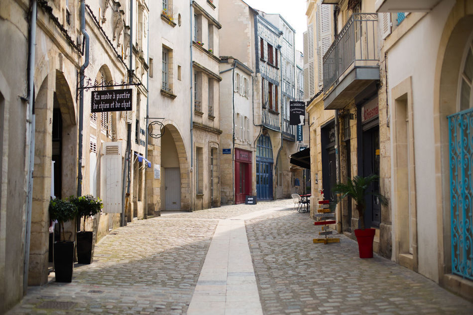 Arch Architecture Building Building Exterior Built Structure City City Life Day Diminishing Perspective Footpath French Long Outdoors Pedestrian Walkway Road Street The Way Forward