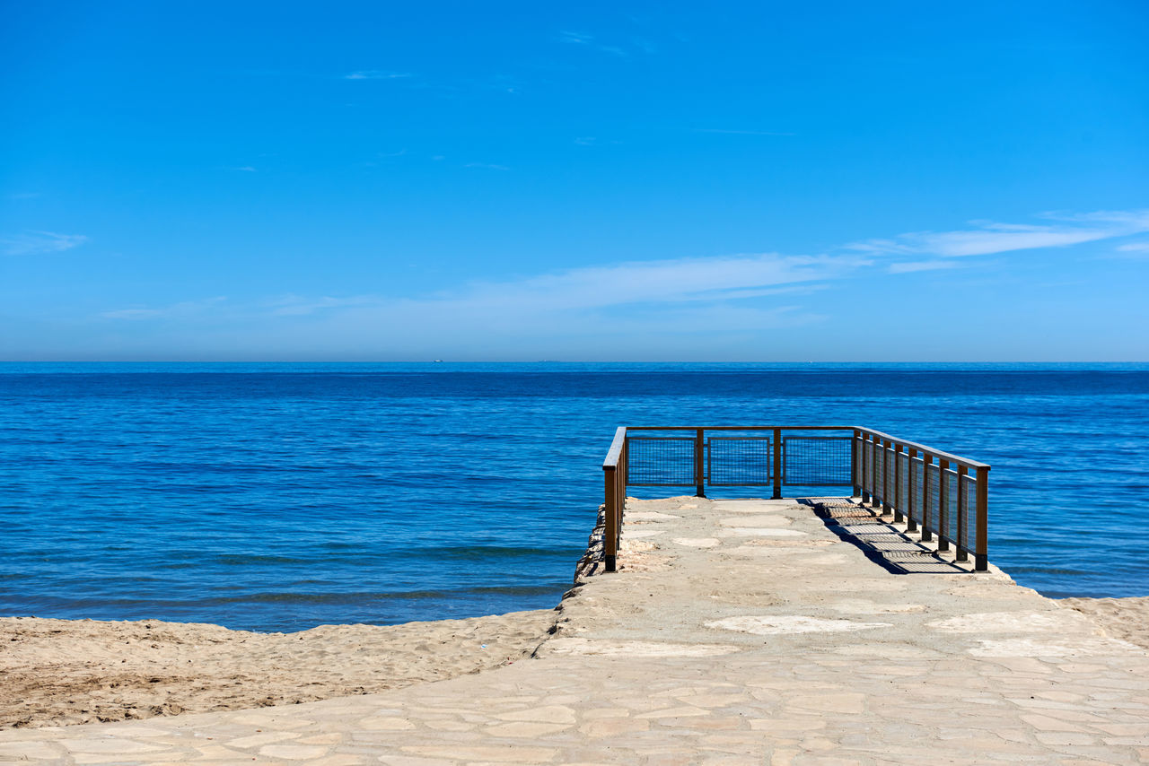 Blue sky and horizon over the Mediterranean sea. Idyllic scene. Vacation concept Beauty In Nature Blue Sea Blue Sky Costa Blanca Day Europe Fence Horizon Horizon Over Water Idyllic Landscape Mediterranean Sea Nature Nobody Ocean Outdoors Path Peaceful Scenery Sea And Sky Seascape Serenity Smooth Water SPAIN Sunny Day