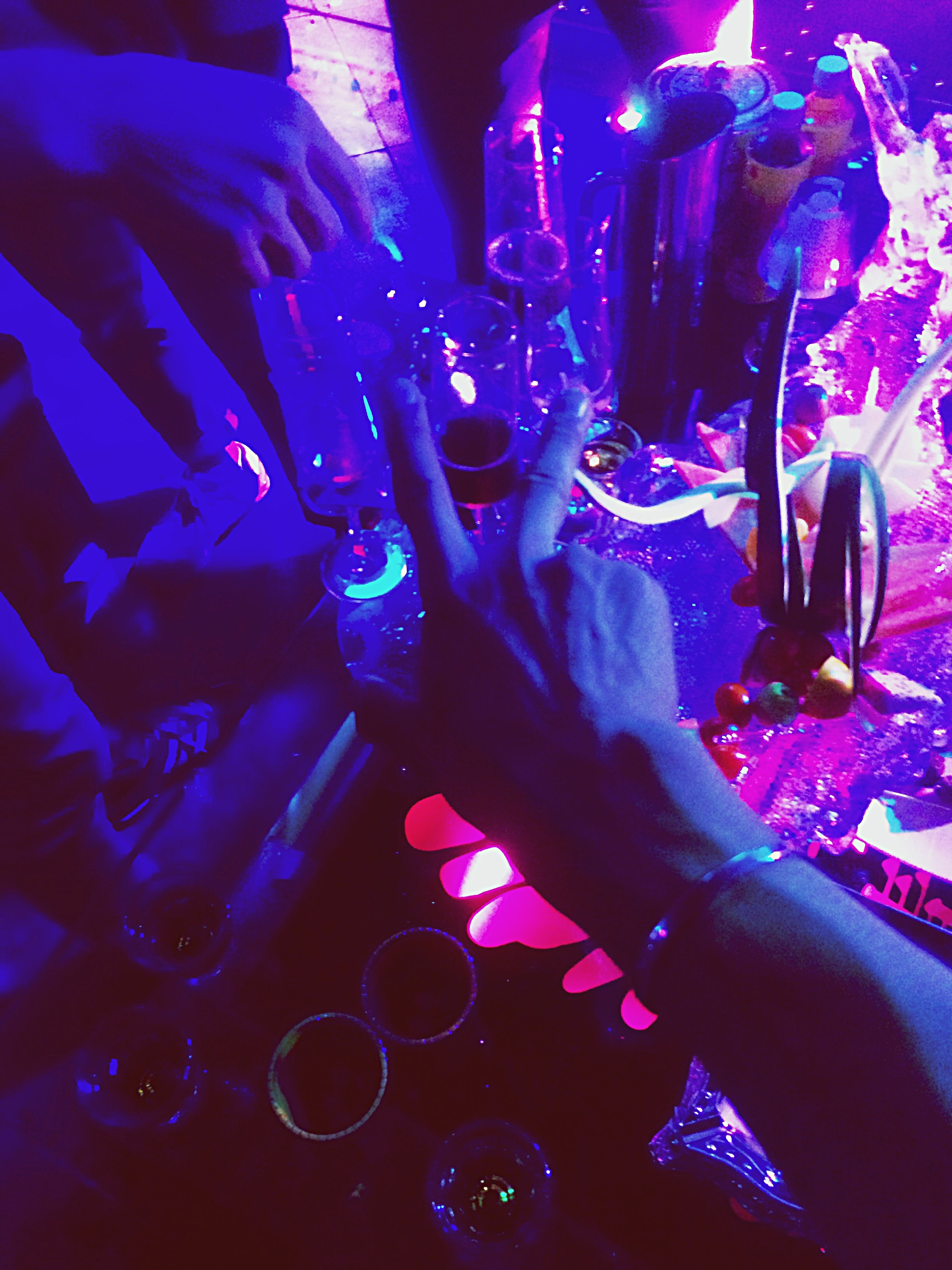 indoors, person, close-up, part of, blue, arts culture and entertainment, nightlife, cropped, illuminated, nightclub, music, shiny, human finger, unrecognizable person, large group of objects, variation, performance