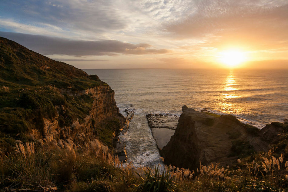 Sea Sunset Rocks And Water Rocks Channels Beauty In Nature Sky No People Nature Horizon Over Water New Zealand Scenery Rock Formation Hikingadventures West New Zealand