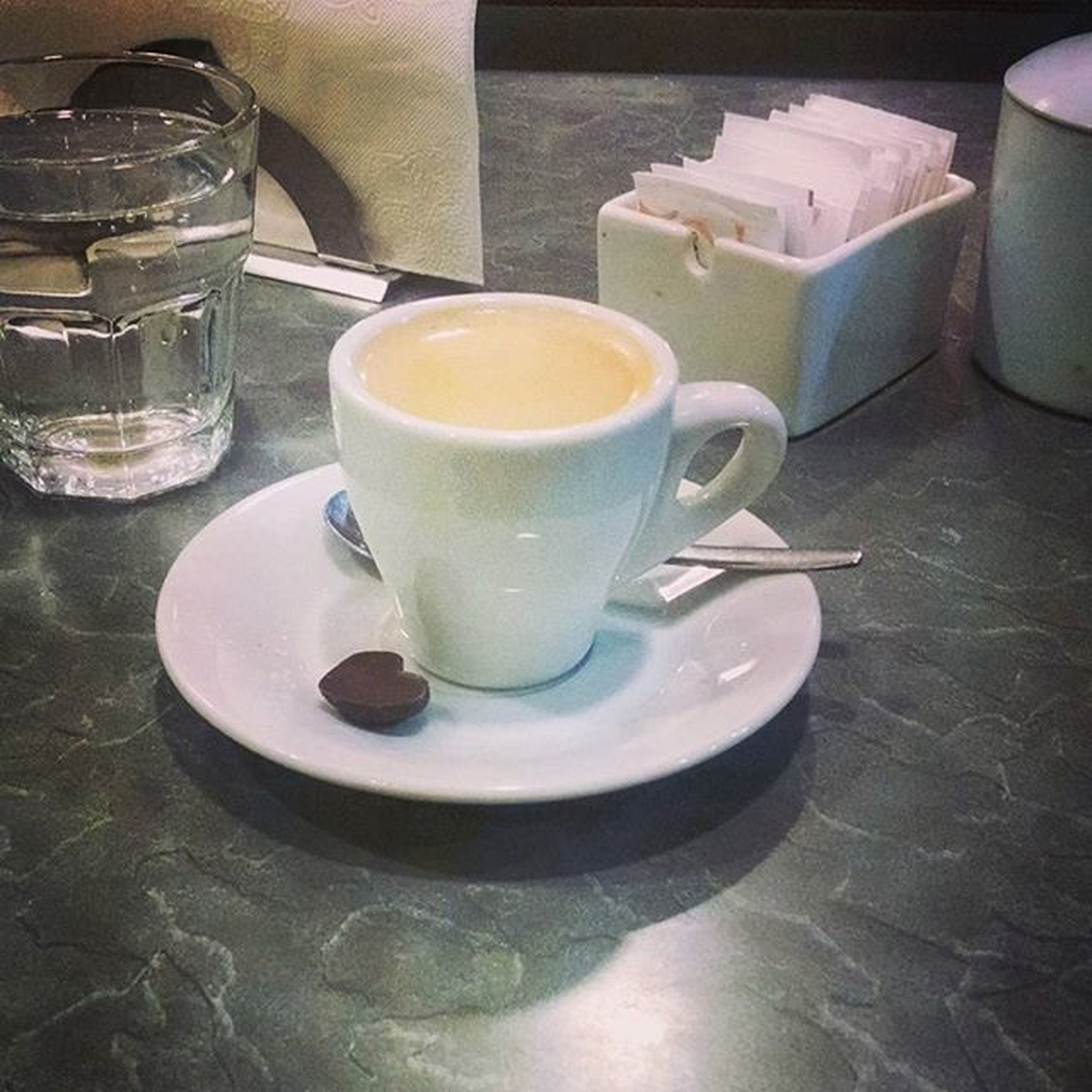 drink, food and drink, refreshment, coffee cup, saucer, coffee - drink, table, indoors, freshness, still life, coffee, cup, spoon, high angle view, frothy drink, tea cup, close-up, beverage, cappuccino, tea