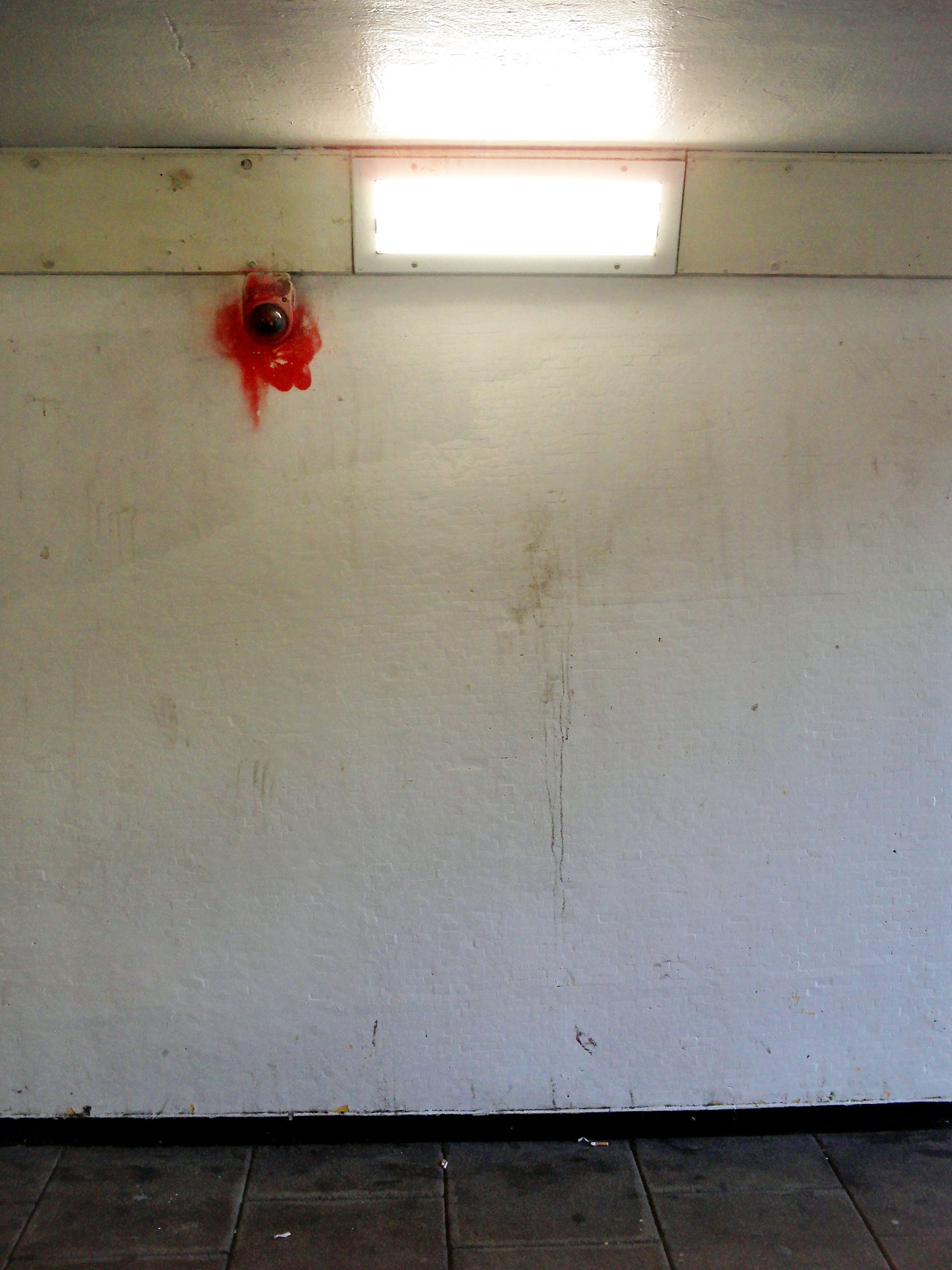 underpass, vandalized security camera. Day Illuminated No People Red Tunnel, Pedestrian, Walkway, Paint, White Wall,