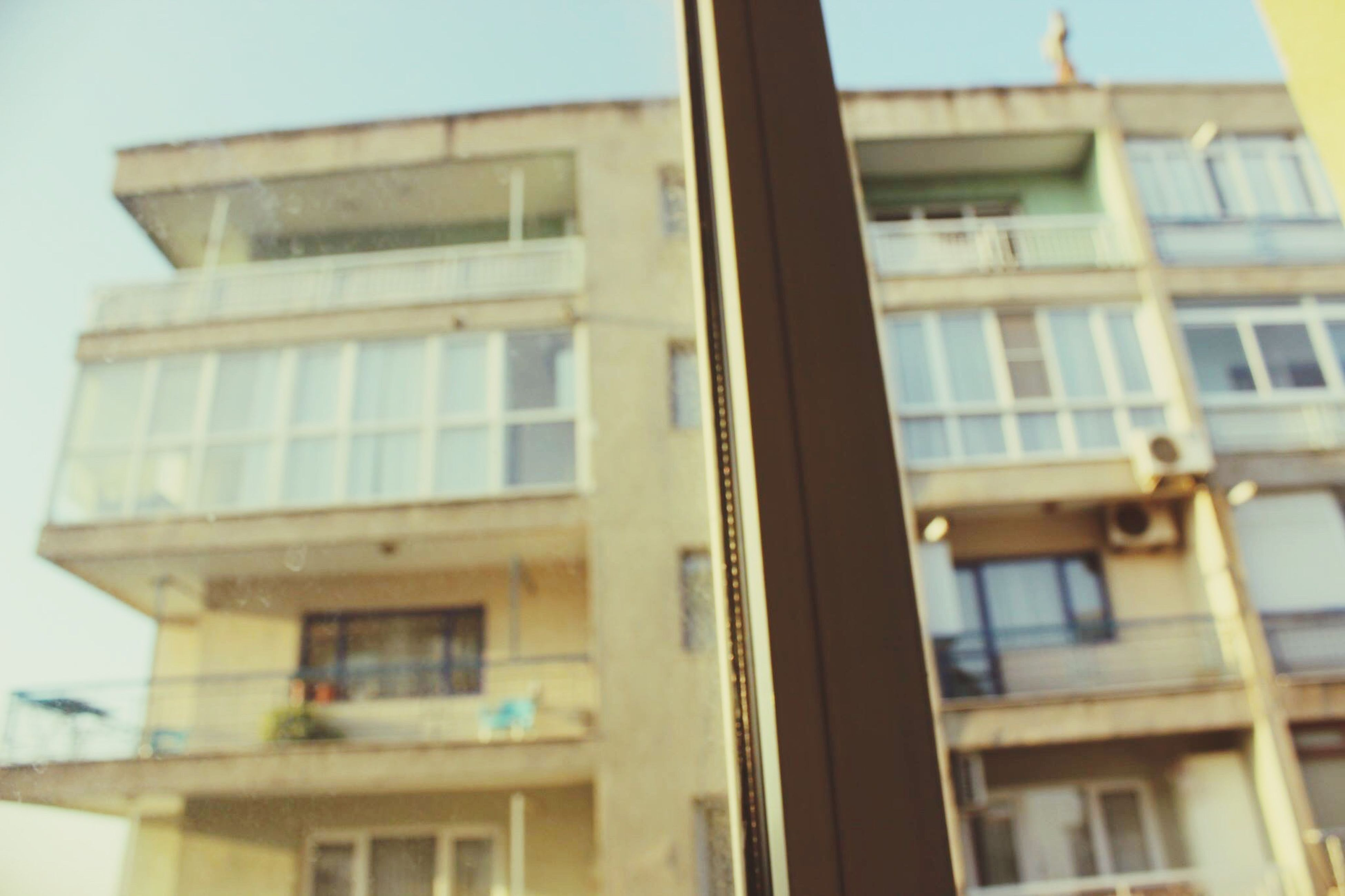 window, architecture, building exterior, no people, built structure, low angle view, balcony, outdoors, day