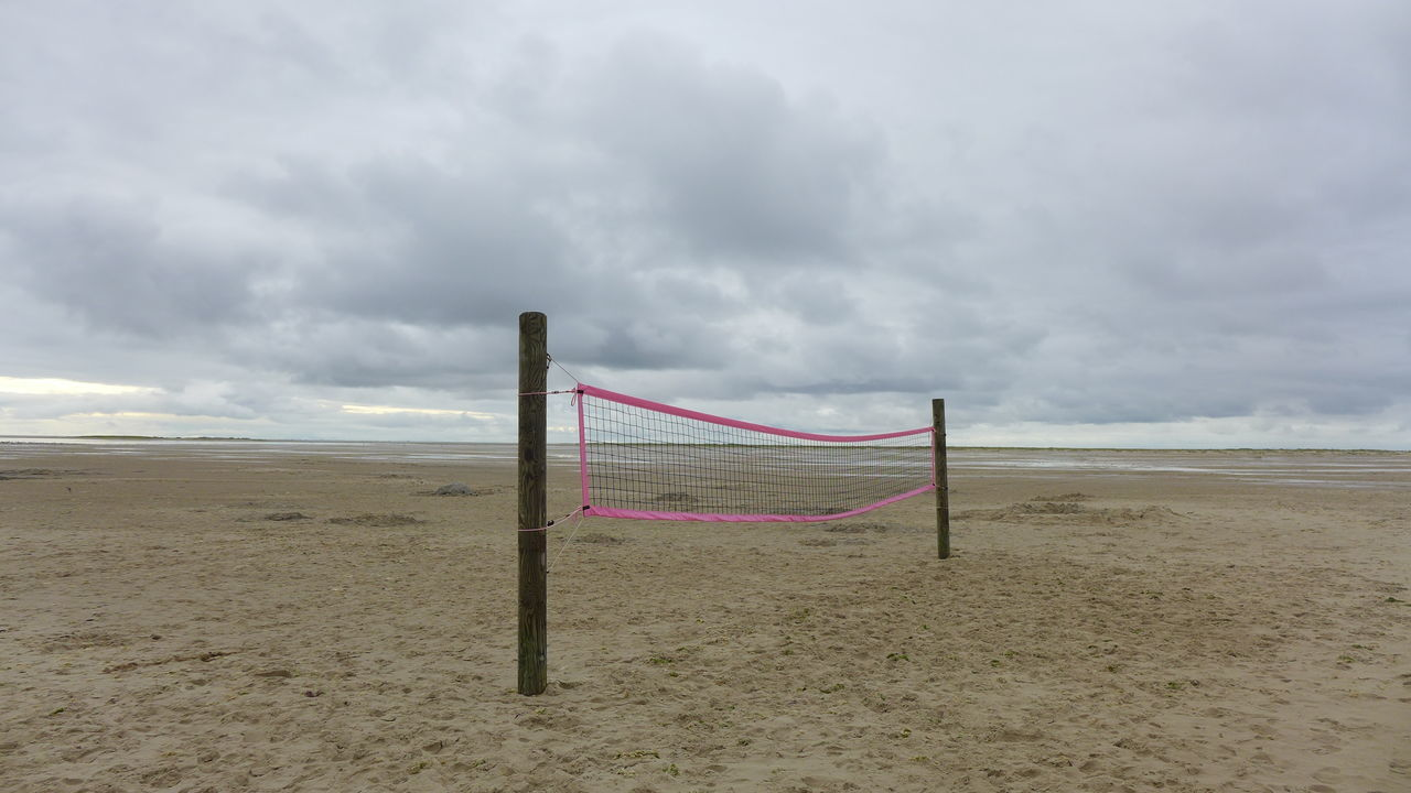 Beach Volleyball in Wittdün auf Amrum Amrum Kniepsand Beach Volleyball Beauty In Nature Cloud Bad Weather North Sea Day Empty Horizon Over Water Idyllic Landscape Nature No People Non-urban Scene Outdoors Remote Sand Sea Shore Sky Premium Collection Getty Images The EyeEm Collection