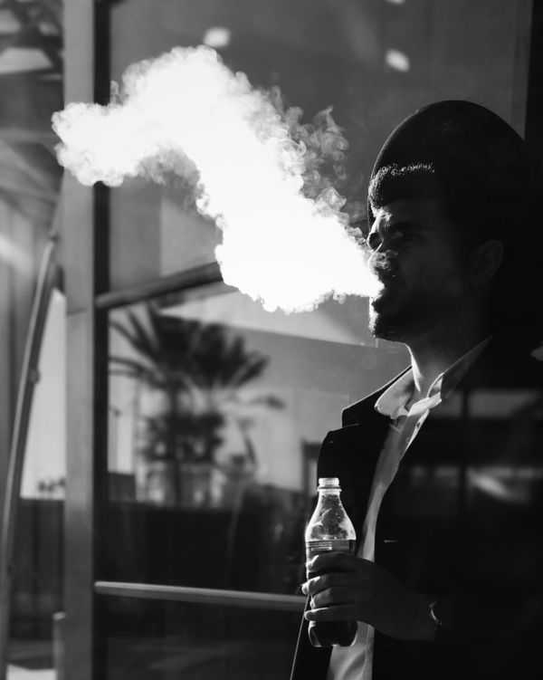 The Portraitist - 2017 EyeEm Awards Smoke - Physical Structure Real People One Person Holding Bad Habit Drink Leisure Activity Food And Drink Focus On Foreground Lifestyles Outdoors Young Adult Men Addiction Close-up Day מיישחורלבן Shotoniphone7plus IPhone7Plus מייאייפון7 Mydbusmoments