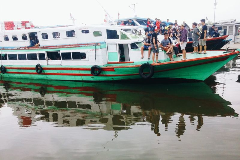 Water Waterfront Reflection Transportation Nautical Vessel Mode Of Transport Boat Group Of People City Life Vacations Togetherness People And Places EyeEm Nature Lover TakeoverContrast Snap a Stranger Enjoy The New Normal Traveling Home For The Holidays