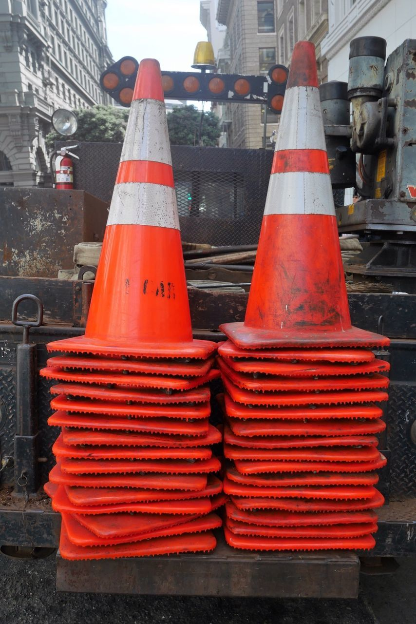 Stacks On Traffic Cones On Metal