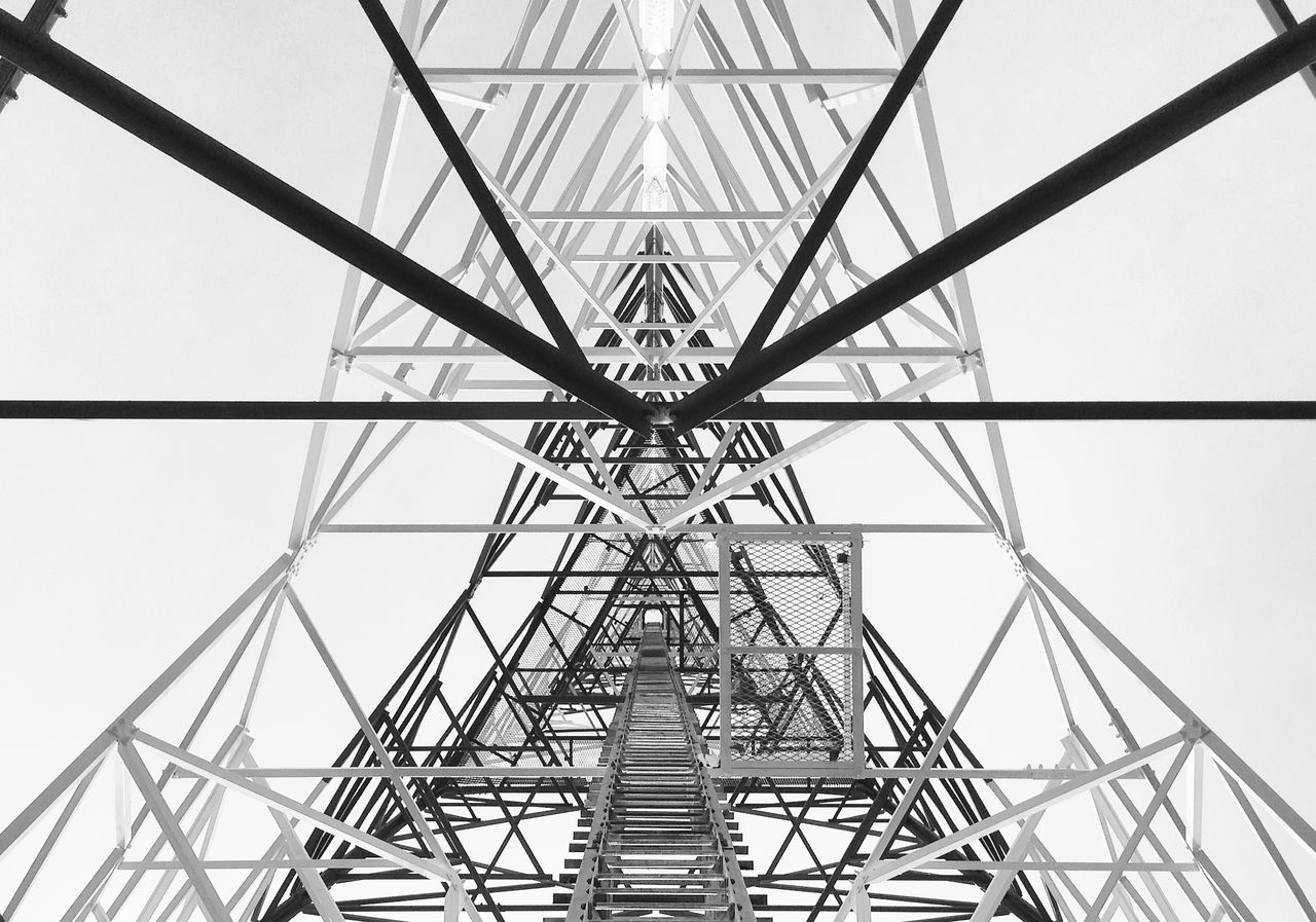 Newly completed telecommunication tower with white and red paint, step ladder in black and white format Architecture Bracing & Truss Building Built Structure Cable Climb Up! Connection Day Electricity Pylon Engineering Erecting High Highrise Looking Up Outdoors Sky Skyscrapers Steel Structure  Step Ladder Tall Tower Up