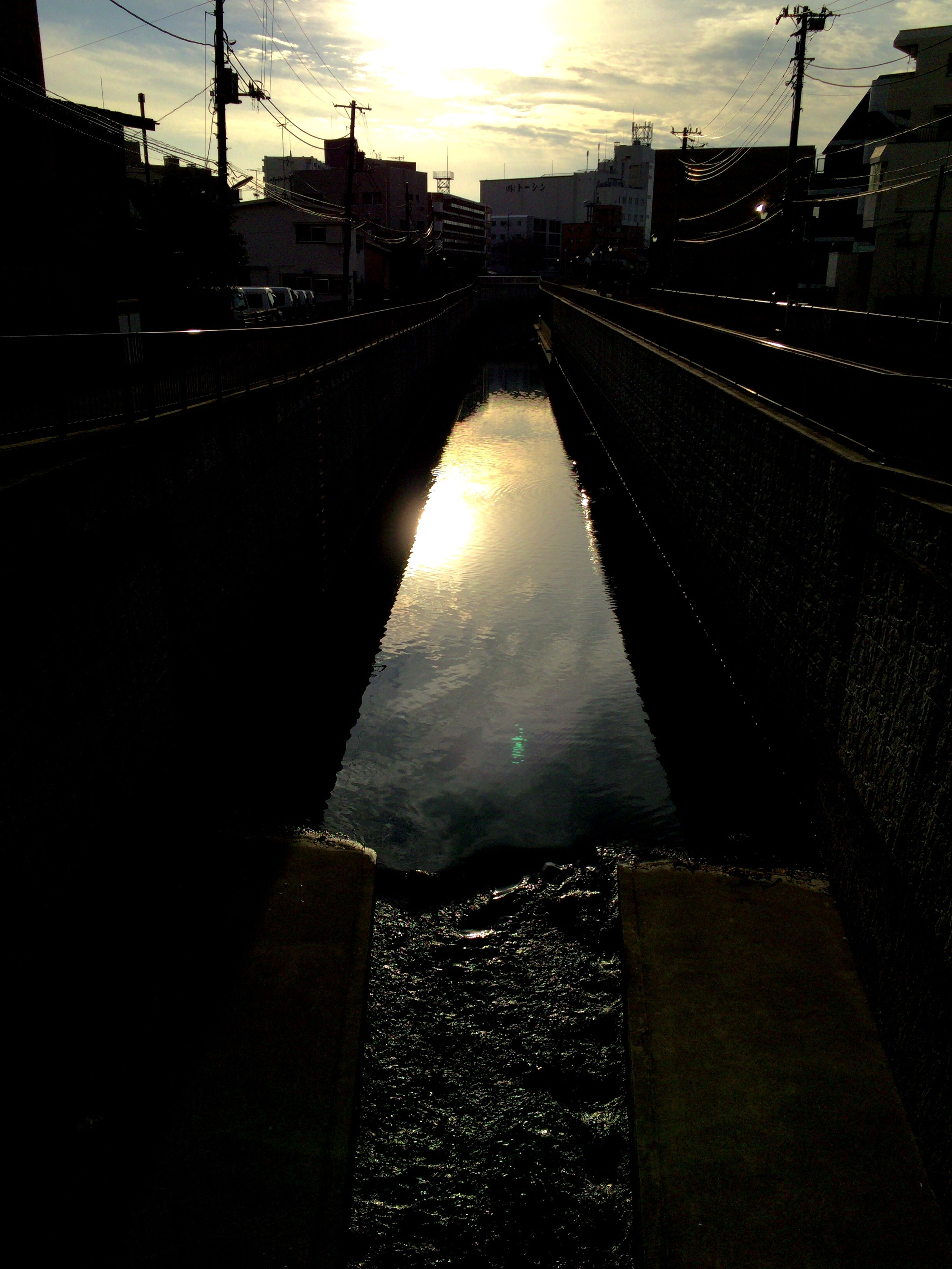 architecture, built structure, water, connection, building exterior, city, sky, sunset, transportation, river, bridge - man made structure, reflection, diminishing perspective, cloud - sky, railroad track, wet, dusk, the way forward, vanishing point, power line