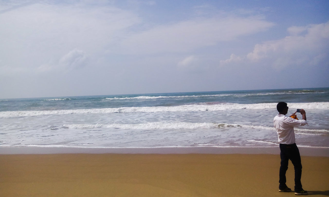 Taking Photos Unidentifiable People Beach Photography Beach Beach View From My Point Of View Bay Of Bengal Seashore Hidden Gems  Man Taking Photo in Ramchandi Beach Odisha India