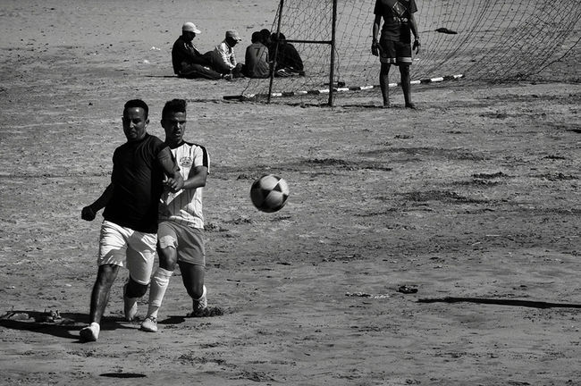 Football Fever Black&white Beach Life Football Time  Football Game On The Beach Localscene Local Culture Blackandwhite Photography Football Life From My Point Of View People Photography Playing Football Light And Shadow Malephotographerofthemonth Footballislife Football Player Football Pitch On The Sand Beachphotography Football Is Here Sports Photography Sports Football - Morocco