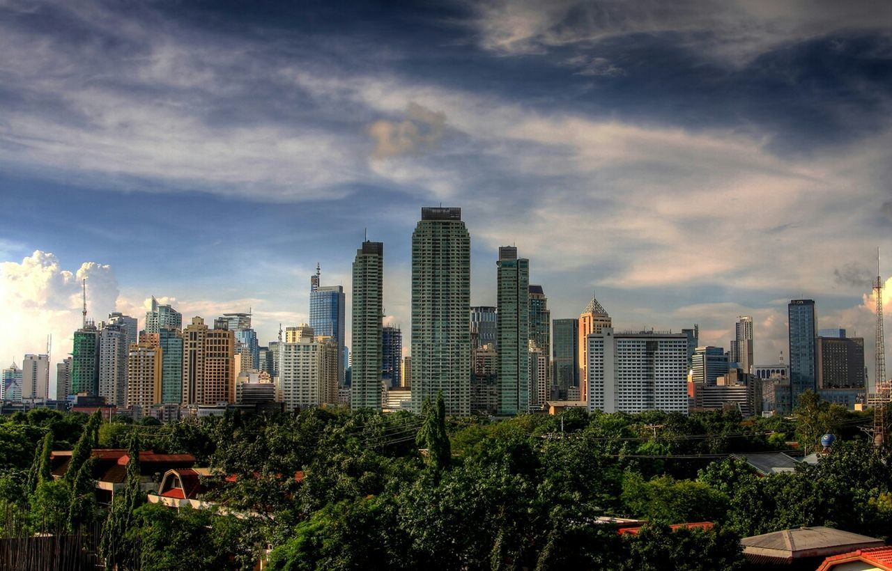 skyscraper, architecture, cityscape, city, building exterior, modern, cloud - sky, sky, urban skyline, development, growth, city life, outdoors, built structure, no people, tree, travel destinations, downtown district, day