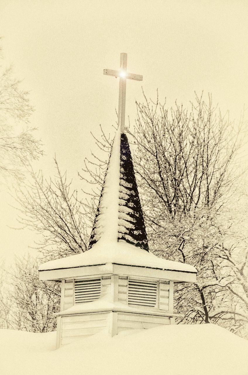 religion, spirituality, snow, cross, winter, bare tree, cold temperature, crucifix, architecture, no people, place of worship, built structure, building exterior, day, tree, low angle view, outdoors, nature, statue, sky, sculpture, clear sky, beauty in nature