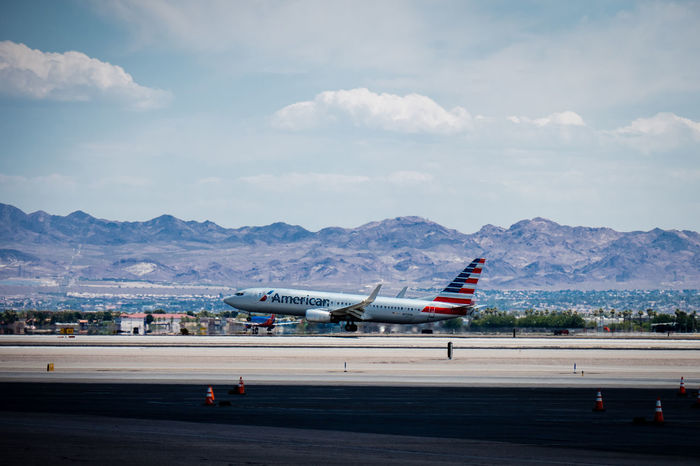 American Airlines Desert Landing Las Vegas Air Vehicle Aircraft Airplane Airplane Wing Airport Airport Runway Cloud - Sky Commercial Airplane Flying Mode Of Transport Mountain Mountain Range Runway Sky Travel