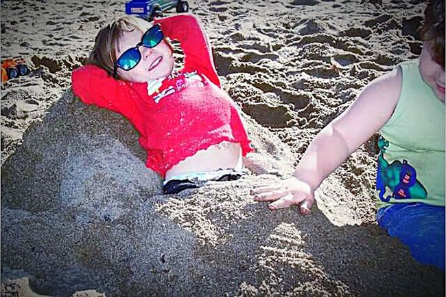 Kids Are Awesome Kids Having Fun Kids Being Kids My Point Of View This Week On Eyeem My Photography A Day At The Park Kid Photography Friends♡ Sand Art Sunglasses Buried In Sand Sand