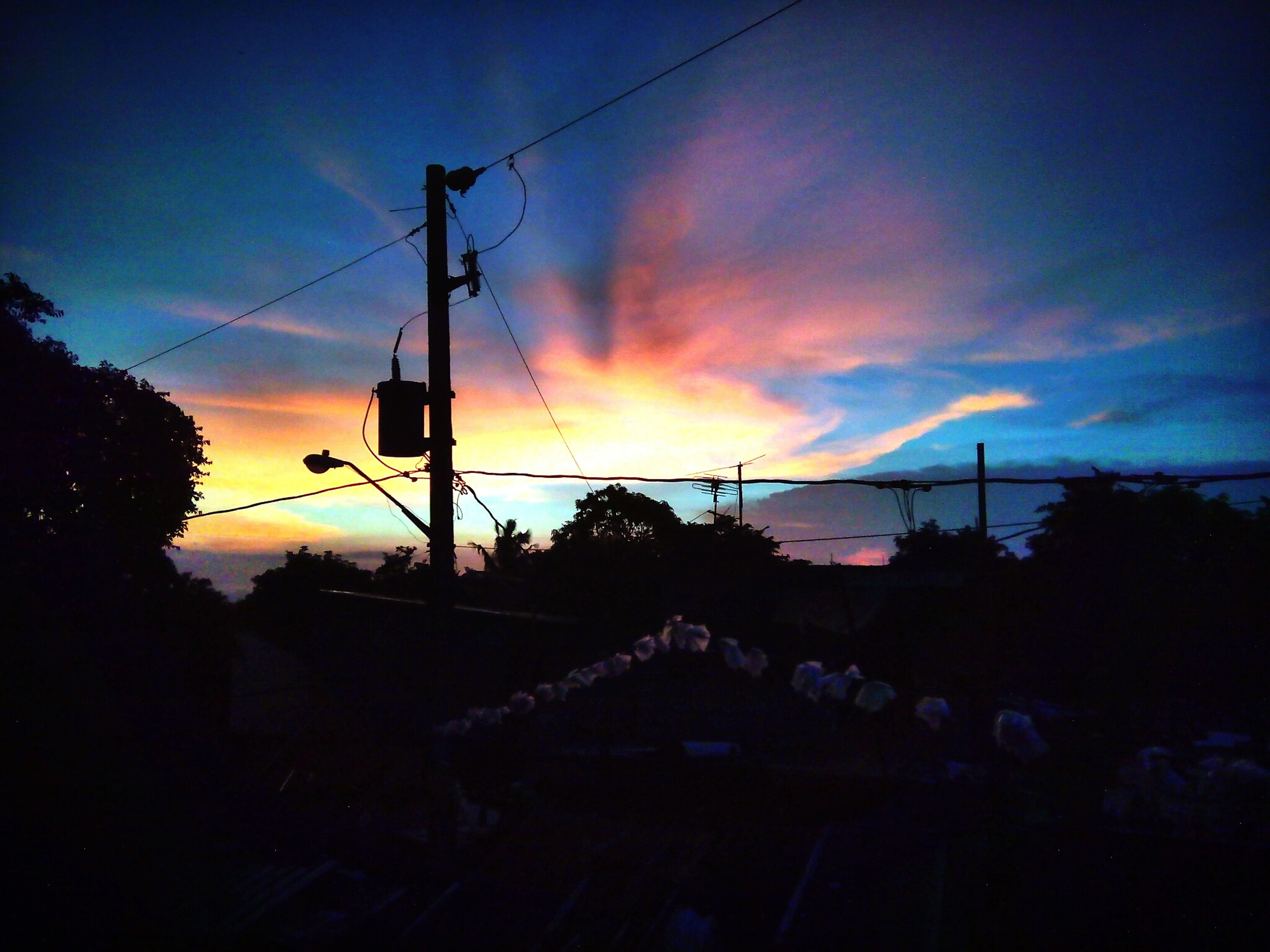 sunset, silhouette, sky, orange color, built structure, cloud - sky, electricity pylon, power line, architecture, building exterior, dramatic sky, dusk, beauty in nature, connection, electricity, scenics, nature, cloud, power supply, tree