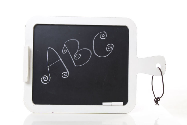 hand written ABC letters on a blackboard with chalk on it Chalk Board Blackboard  Close-up Day Hand Writing Indoors  No People White Background
