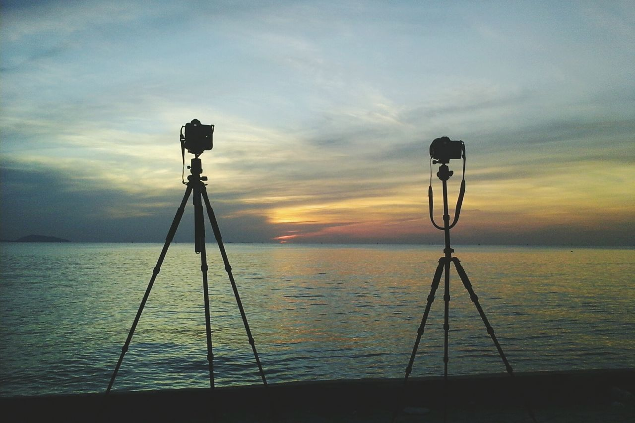 Silhoette of two camera Chonburi ,Thailand Silhouette Clouds And Sky Tripod Leisure Activity Hobby DSLR Photography Phtotography Sea Abstract Nature Traveling Summer Sunset Camera Adventure Activity Thailand Sky Fresh Air :) Lifestyles Background Landscape Travel Photography Travel