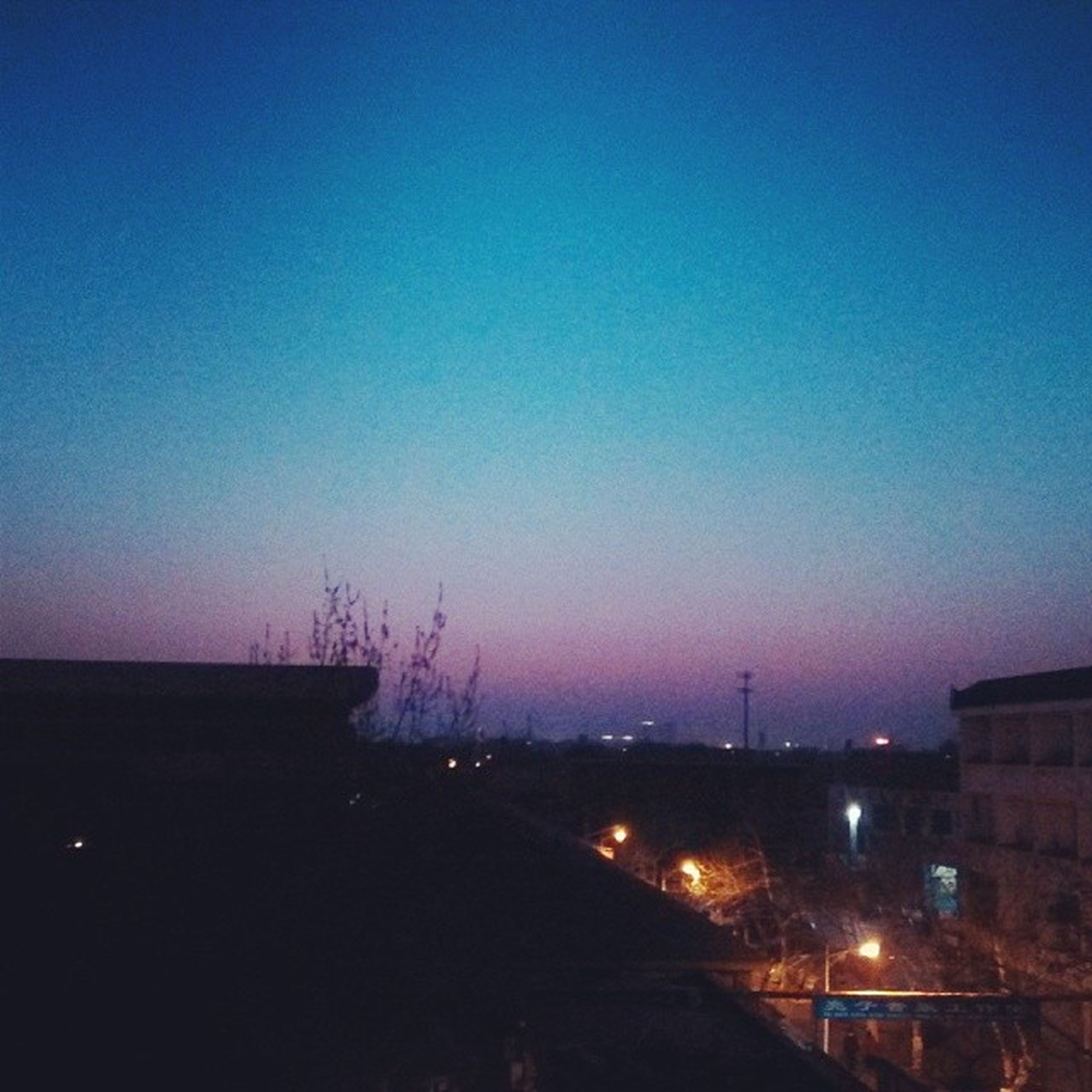copy space, clear sky, illuminated, building exterior, built structure, architecture, night, dusk, blue, city, sunset, silhouette, landscape, cityscape, outdoors, dark, no people, nature, high angle view, sky