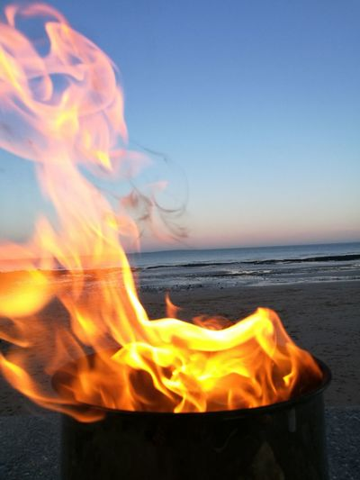 Flame Heat - Temperature Sea Burning Danger Motion Beach Sunset RISK Nature Outdoors Clear Sky No People Horizon Over Water Sky Blue Night Beauty In Nature Close-up Water Done That.