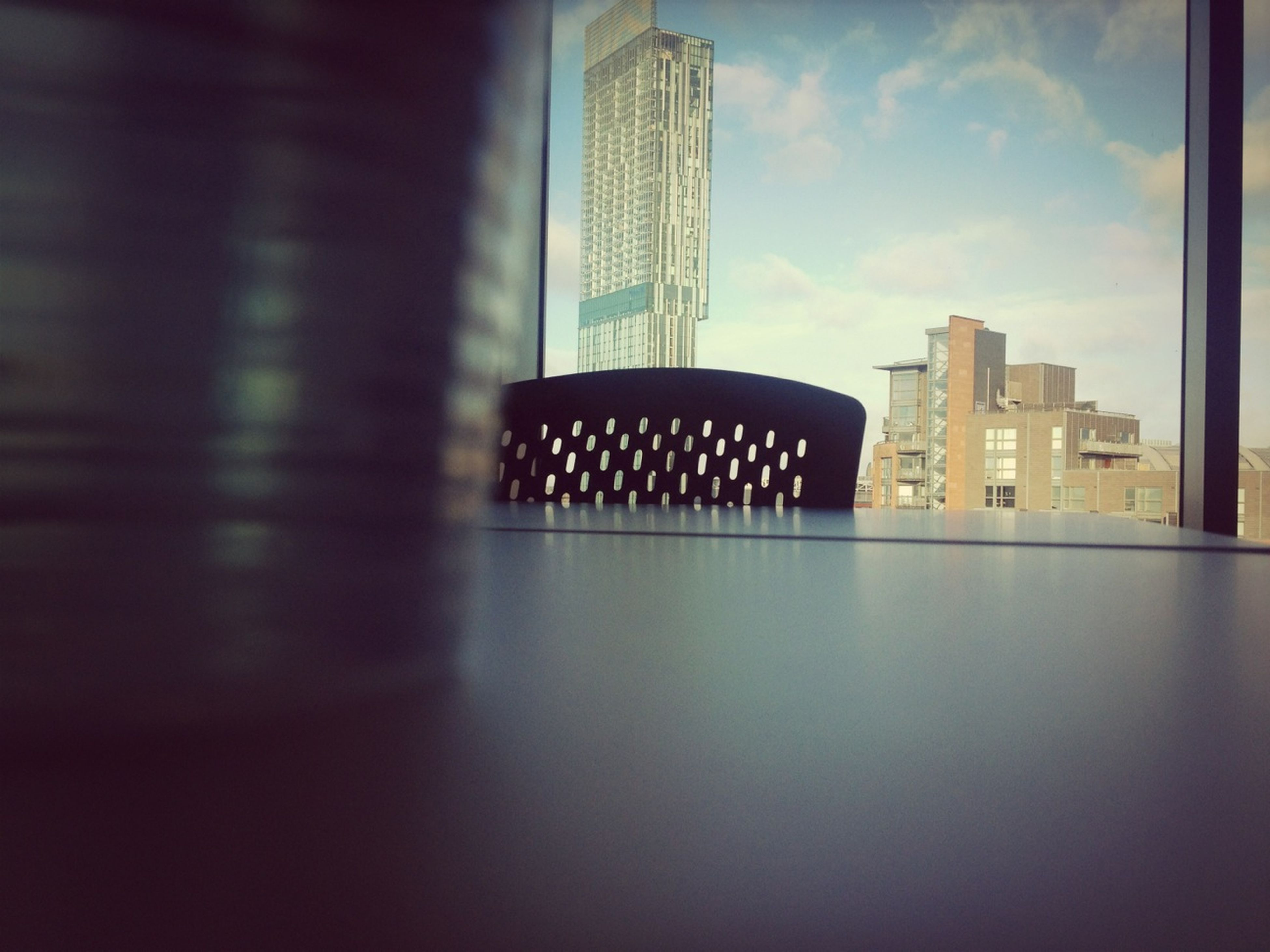 architecture, built structure, modern, building exterior, indoors, skyscraper, office building, city, tall - high, reflection, building, sky, no people, glass - material, tower, window, absence, low angle view, empty, day