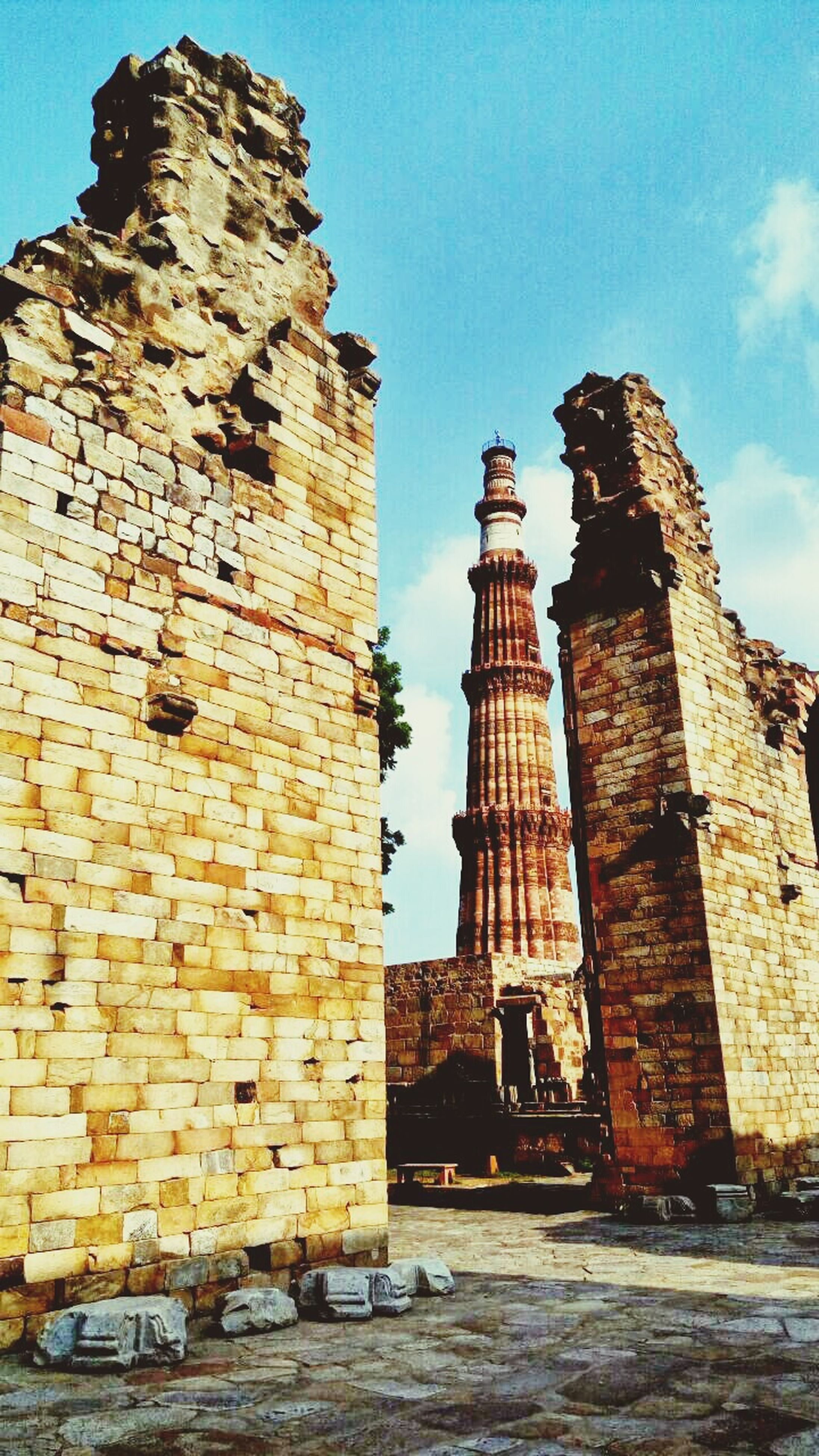 architecture, built structure, building exterior, old ruin, history, brick wall, old, tower, damaged, sky, medieval, the past, travel destinations, ancient, ruined, blue, famous place, outdoors, brick, deterioration, day, weathered, bad condition, fortified wall, fort