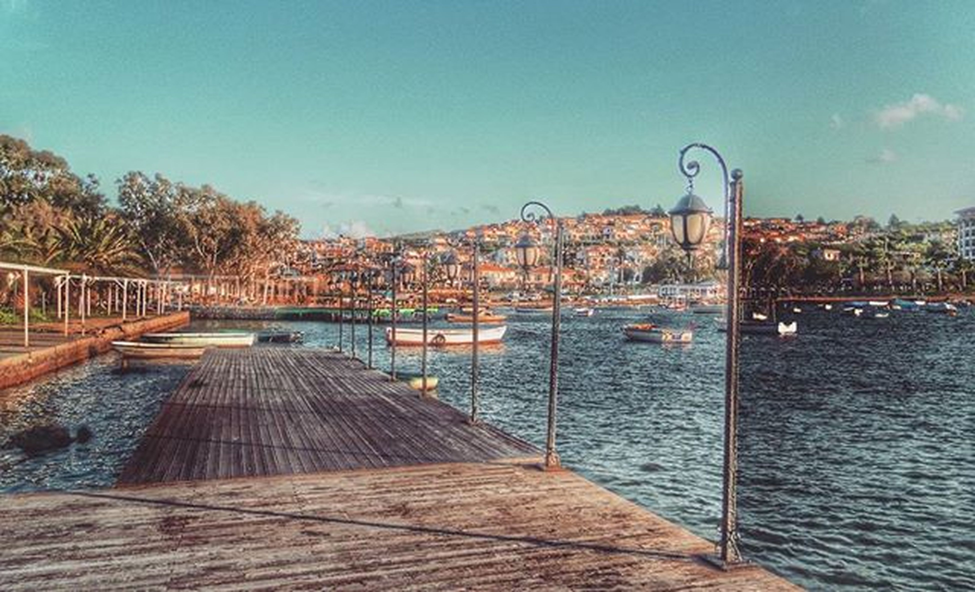water, built structure, pier, clear sky, sky, railing, architecture, transportation, blue, river, tranquility, wood - material, tranquil scene, the way forward, lake, nature, rippled, day, connection, tree