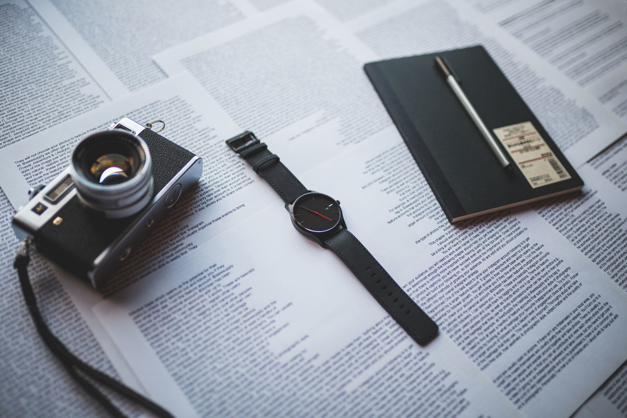 35mm Book Camera Desk Directly Above Education Film Camera High Angle View Indoors  Late No People Office Supply Open Paper Papers Pen Still Life Time Vintage Vintage Camera Watch Watches Workspace Wrist Watch Wristwatch