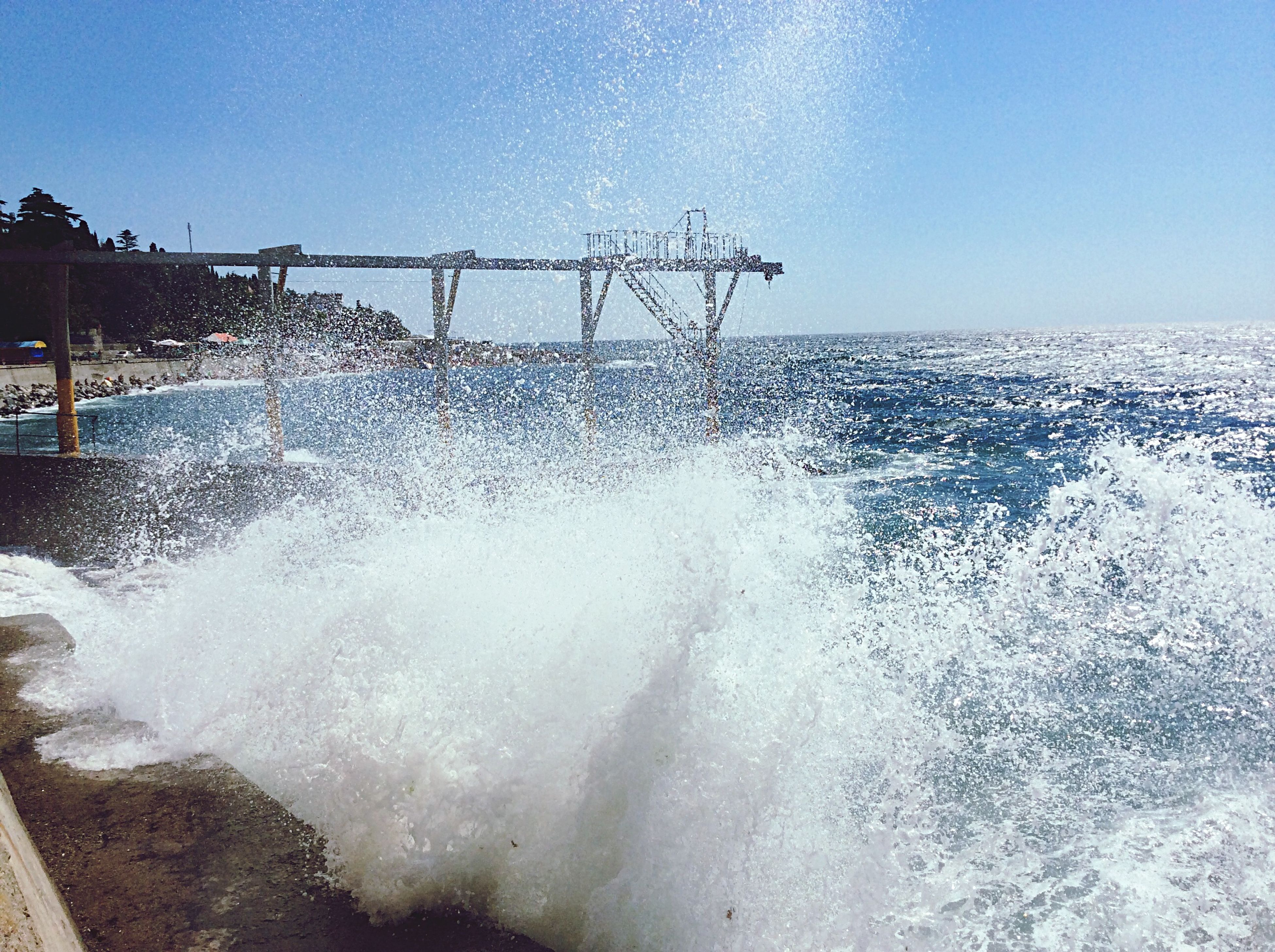 water, sea, wave, splashing, motion, surf, horizon over water, clear sky, scenics, sky, beauty in nature, shore, nature, beach, power in nature, outdoors, wet, day, sunlight, long exposure
