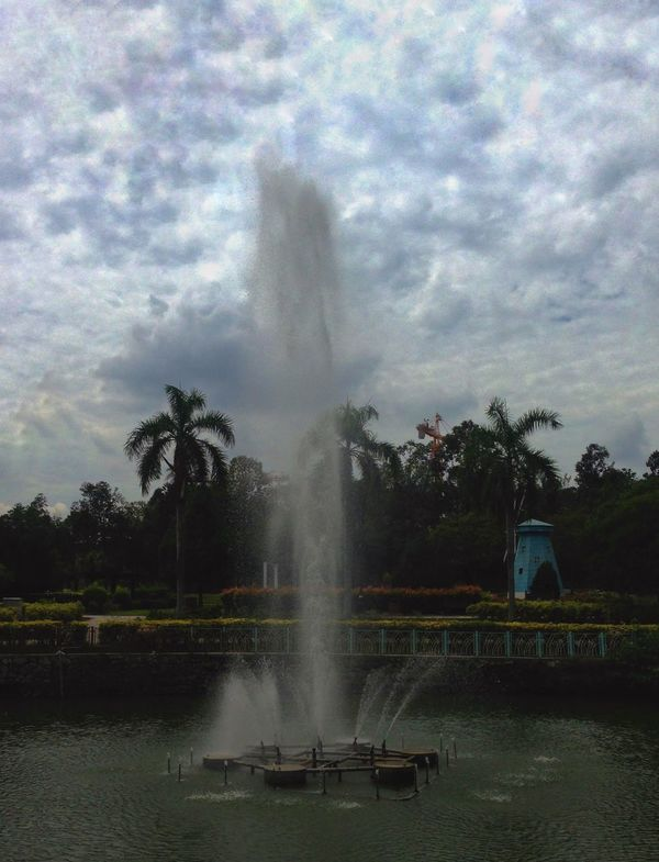 Water Splashing Fountain Spraying Motion Power In Nature Sky Outdoors Nature Tree Long Exposure Cloud - Sky Palm Tree Erupting Day Geyser No People Beauty In Nature Iphonegraphy IPhone Photography IPhone Art IPhone5 IPhone Y0l Y0lmobilegraphy