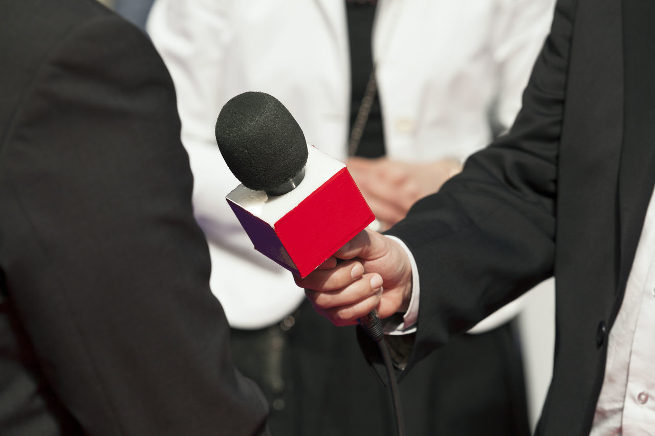 Reporter making interview with businessman or politician Adult Audio Broadcasting Business Businessman Close-up Day Event Human Hand Jourlanist Media Media Interview Men Microphone People Politician Press Red Reporter Spokesman Suit Two People