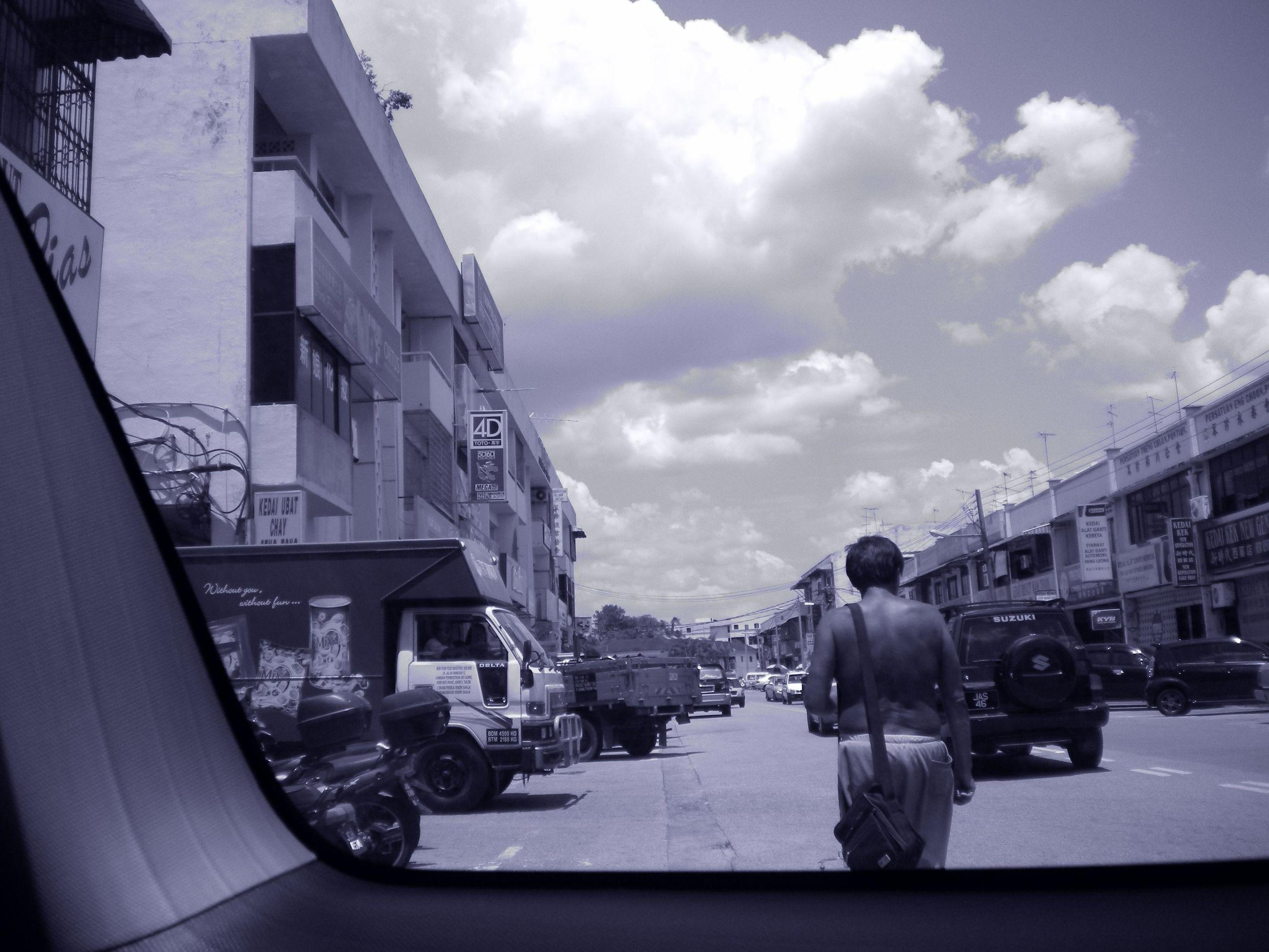 transportation, mode of transport, building exterior, land vehicle, architecture, car, built structure, sky, street, men, city, cloud - sky, lifestyles, city life, cloud, road, rear view, person