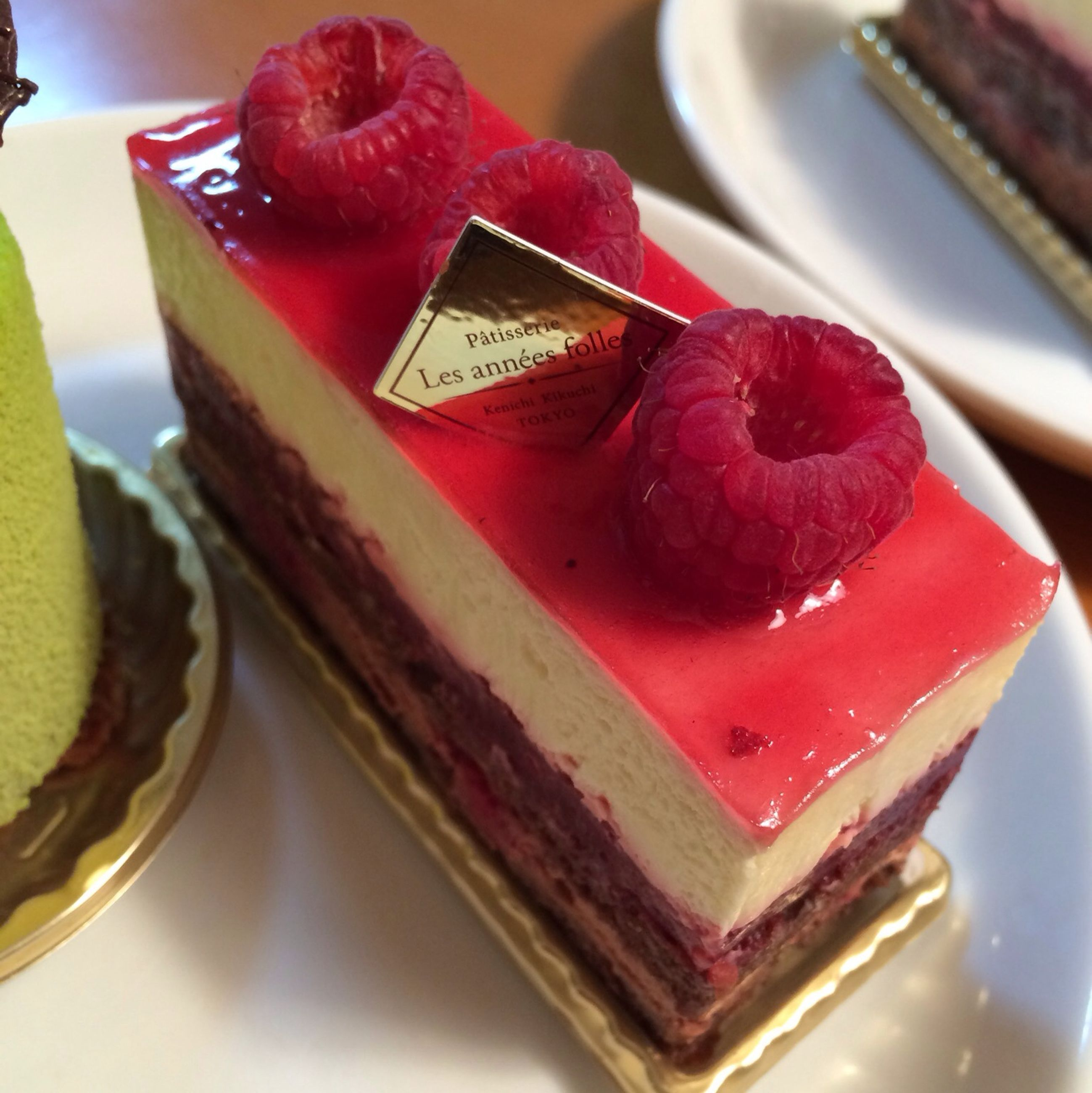 food and drink, freshness, indoors, food, sweet food, still life, dessert, indulgence, ready-to-eat, close-up, cake, unhealthy eating, table, temptation, plate, strawberry, fruit, chocolate, serving size, red