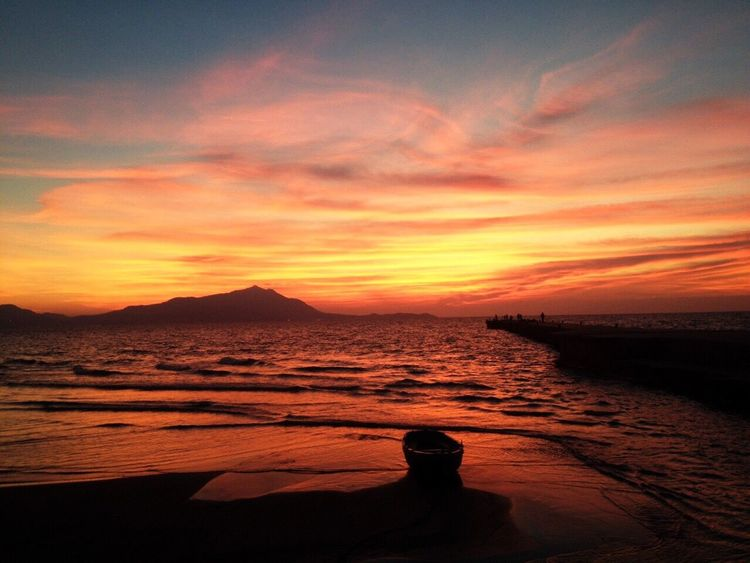 Sunset Beauty In Nature Scenics Silhouette Nature Orange Color Beauty In Nature Photography Boat Seascape Amazing Sunset Silhouettes Sunset_collection Sunsetporn Sky Sea Water Outdoors Beach One Person Mountain Day People The Great Outdoors - 2017 EyeEm Awards