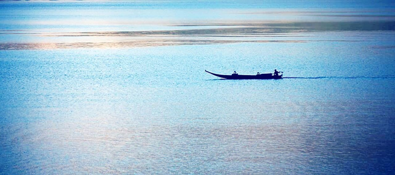 water, sea, silhouette, waterfront, transportation, nature, outdoors, tranquil scene, scenics, one person, tranquility, men, beauty in nature, real people, one man only, day, nautical vessel, only men, sky, people