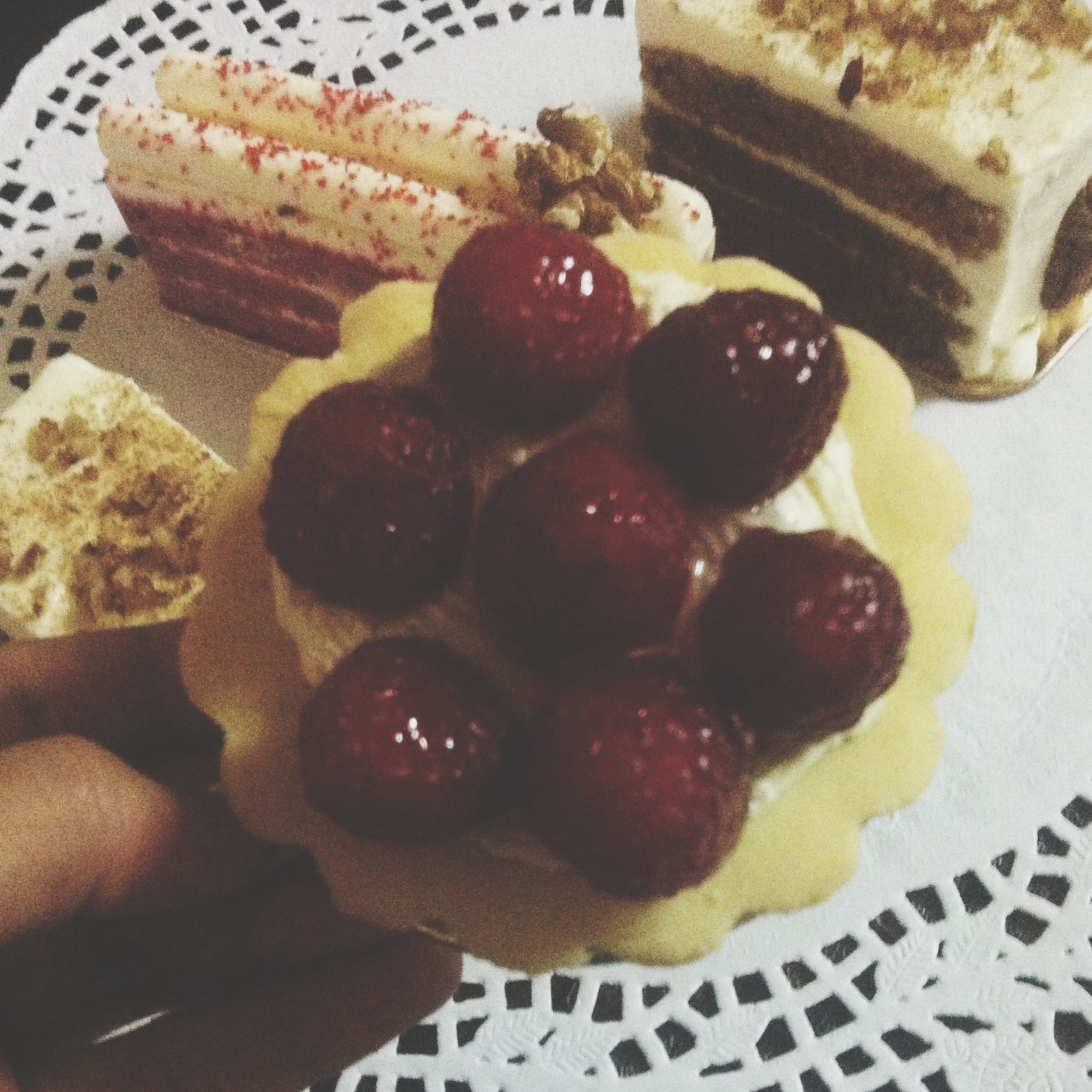 food and drink, food, indoors, freshness, sweet food, fruit, ready-to-eat, dessert, still life, strawberry, indulgence, plate, unhealthy eating, table, close-up, high angle view, temptation, cake, chocolate