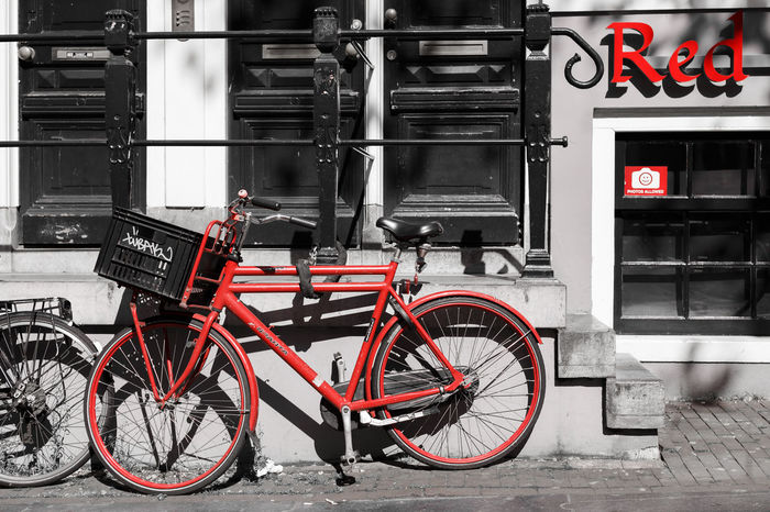 The Red Bike District Amsterdam Bicycle Capital Cities  Cycling Day Europe Holland Holland❤ Land Vehicle Mode Of Transport Nederland Netherlands Parked Parking Red Red Light District Selective Color Side View Sign Stationary Street Streetphotography Transportation Your Amsterdam
