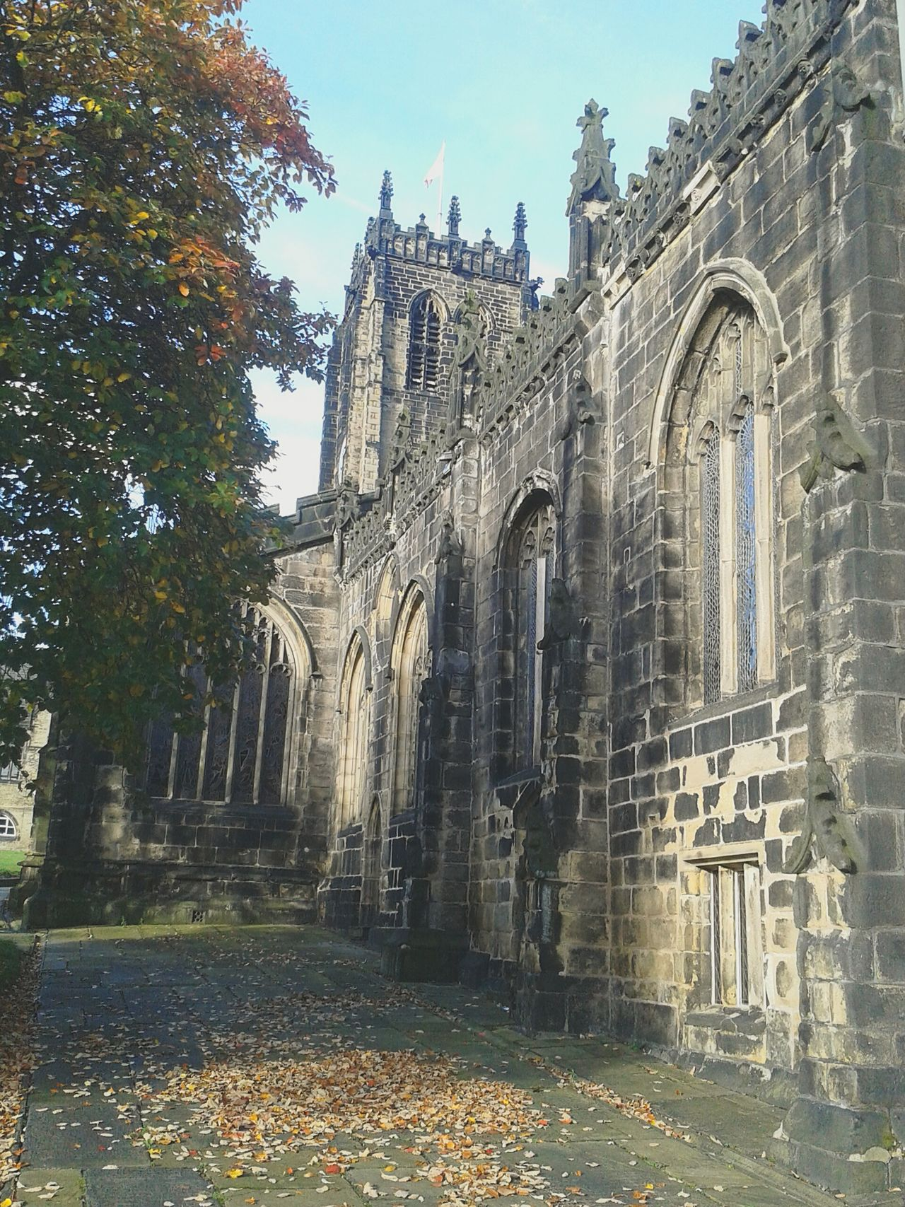 Sunlight And Shadow Peaceful Place Autumn Leaves Stonework Architectural Detail Medieval Churchyard Beautiful Stonework Churches Leaded Windows