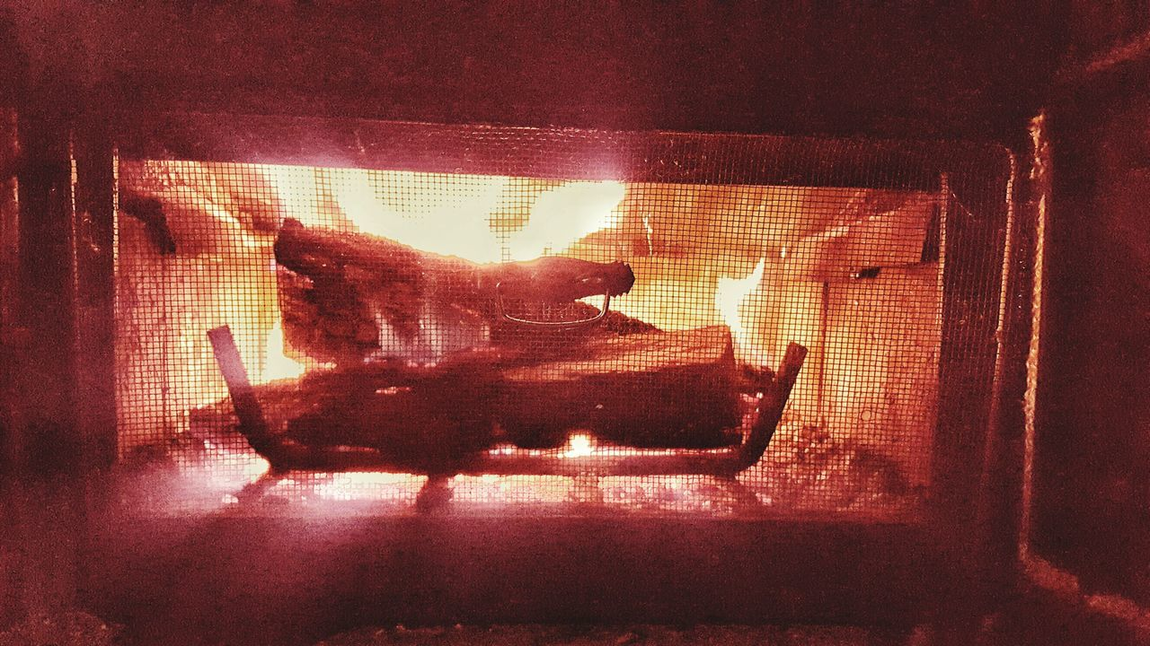 Hot fire crackling in an old wood stove. Fireplace Woodstove Burning Flames Warmth Relaxing Open Flame Winter Cold Night Escapism Soothing Defrosting Cold Weather Saranac Lake Bright Light Adirondacks Wintertime Cabin Heat - Temperature Heat Source Burning Wood crackling
