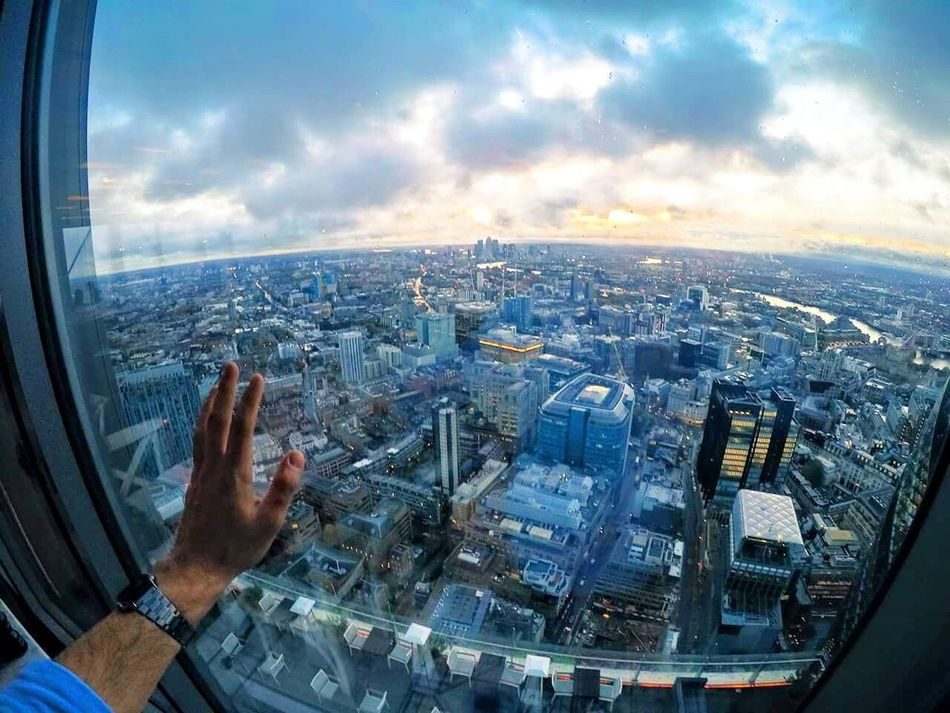 Gopro Goprohero4 Goprouniverse Goprooftheday GoPrography London Cityscape City Aerial View Cloud - Sky Building Exterior Travel Destinations Architecture Airplane Urban Skyline Business Finance And Industry Sky Human Hand One Person Skyscraper Outdoors Human Body Part Adults Only Air Vehicle People