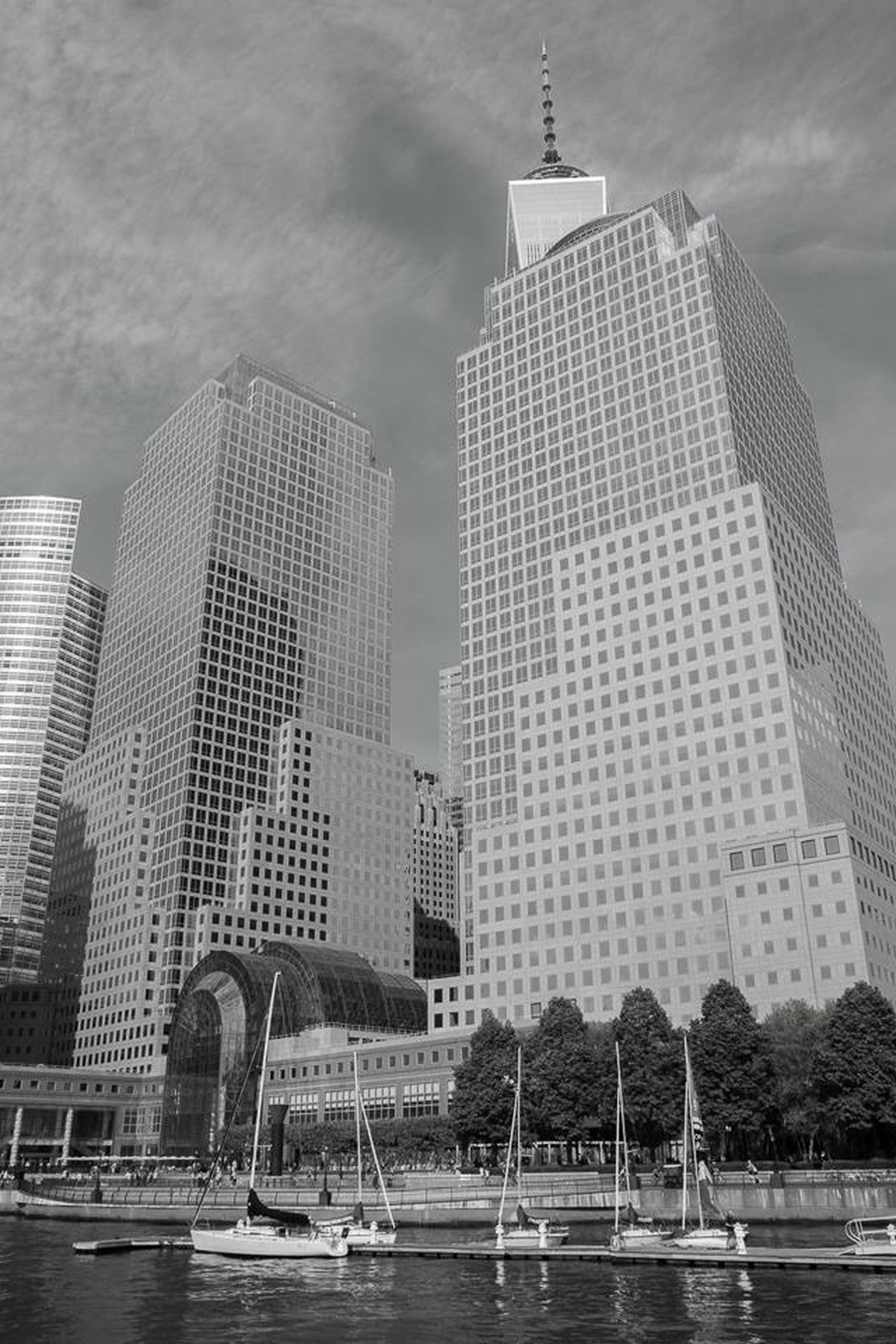 architecture, building exterior, built structure, skyscraper, water, sky, cloud - sky, modern, development, travel destinations, city, day, outdoors, tall, no people, urban skyline, tree