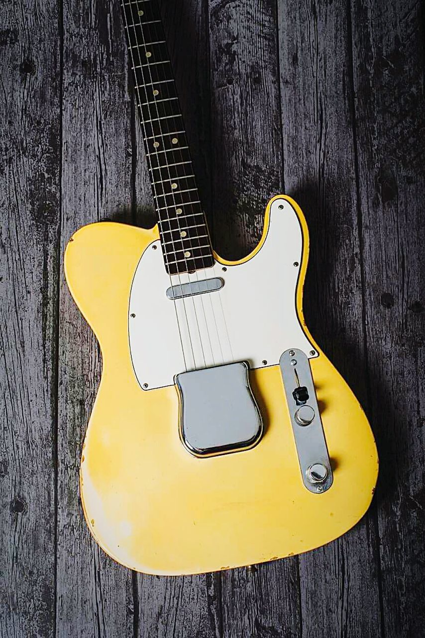wood - material, music, guitar, indoors, electric guitar, arts culture and entertainment, yellow, no people, musical instrument, musical instrument string, close-up, day