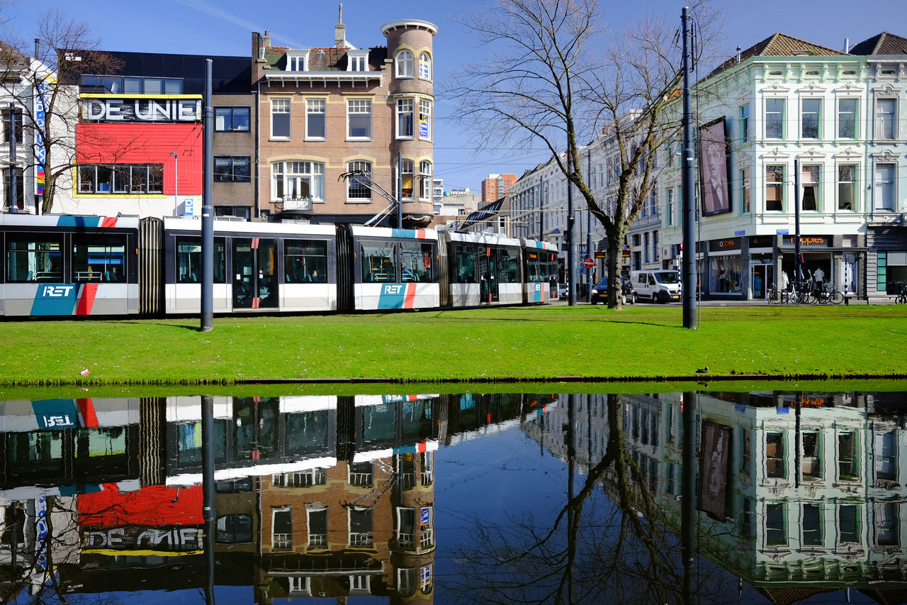 Tram reflections @ Rotterdam Architecture Bare Tree Building Exterior Built Structure City Color Day Grass Holland Netherlands No People Outdoors Reflection Rotterdam Sky Subway Tram Transport Transportation Travel Destinations Water