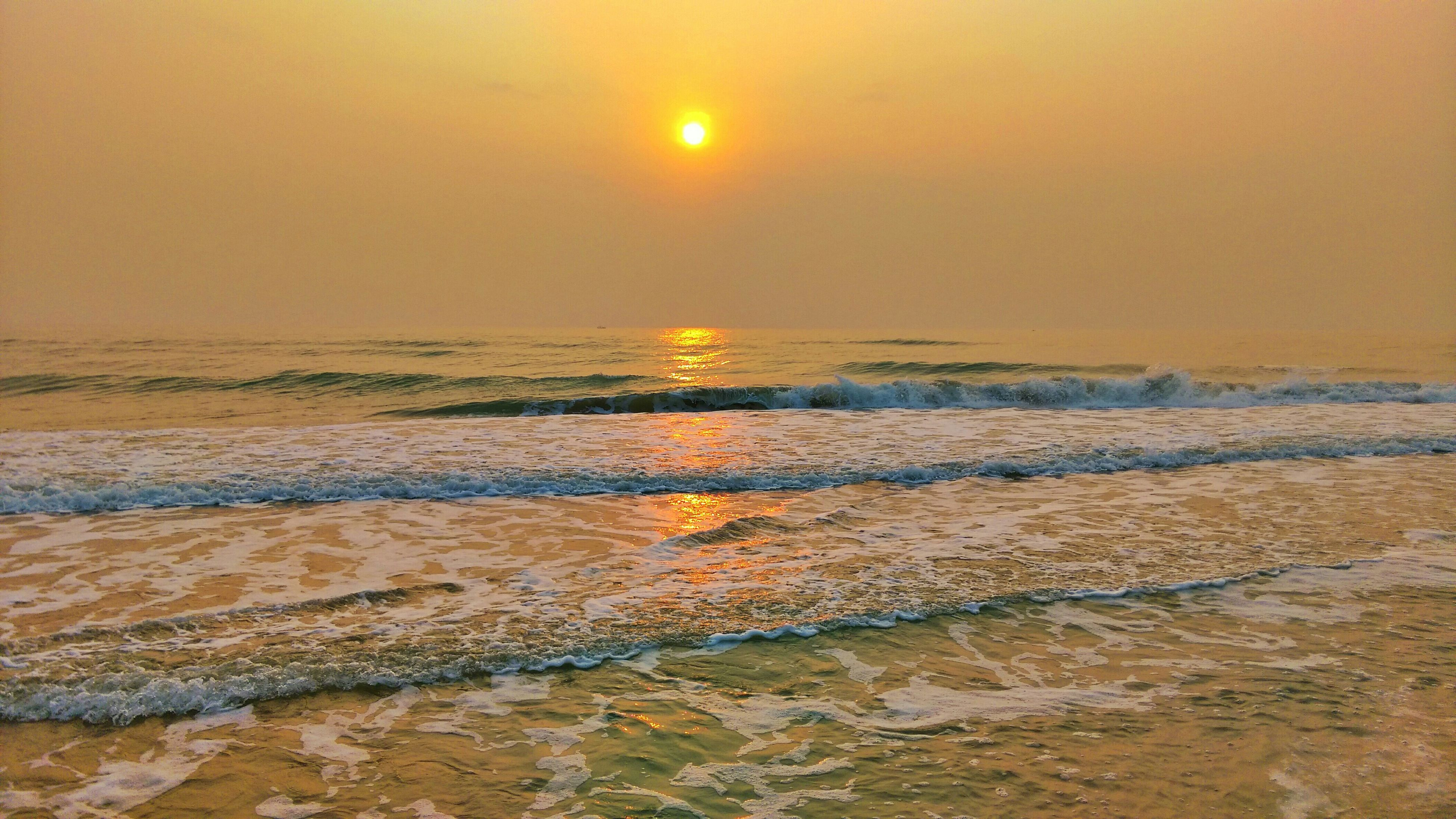 sea, sunset, water, horizon over water, beach, scenics, sun, tranquil scene, shore, beauty in nature, tranquility, orange color, sky, wave, nature, idyllic, reflection, sand, remote, sunlight