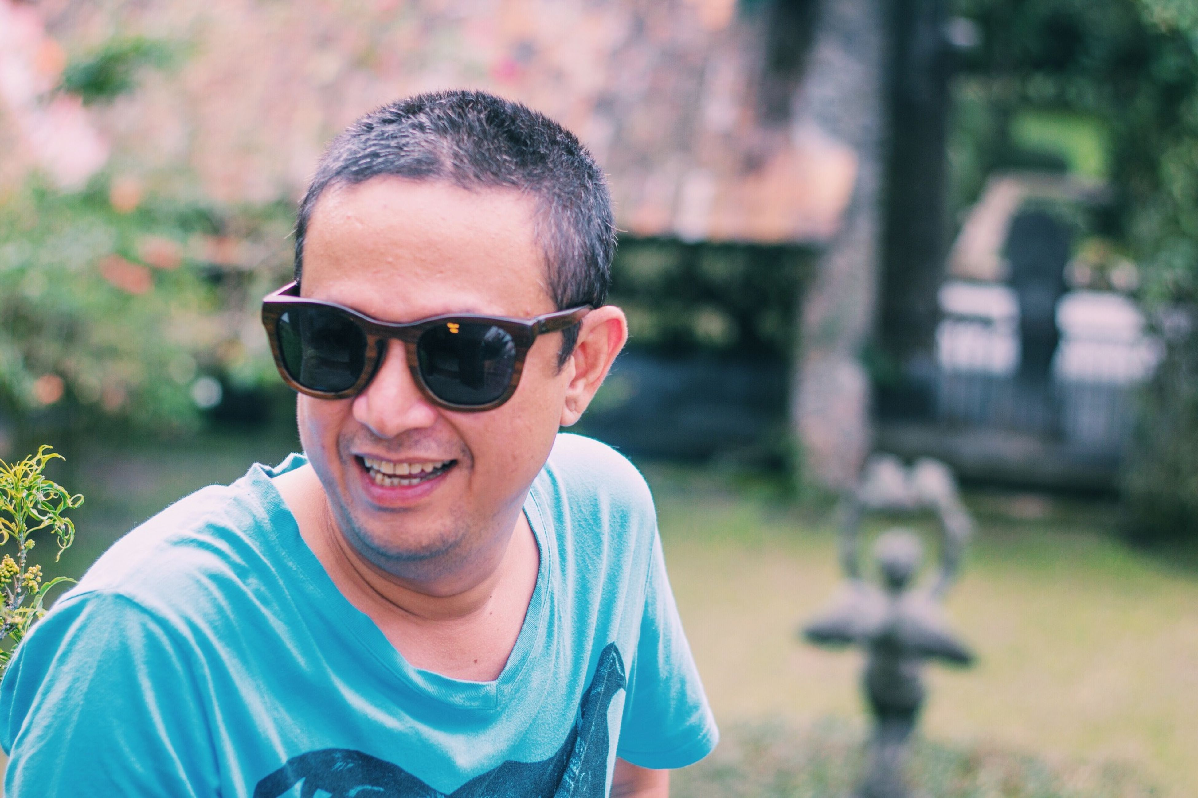person, portrait, looking at camera, lifestyles, leisure activity, headshot, focus on foreground, smiling, front view, sunglasses, casual clothing, happiness, elementary age, boys, childhood, young adult, close-up, day