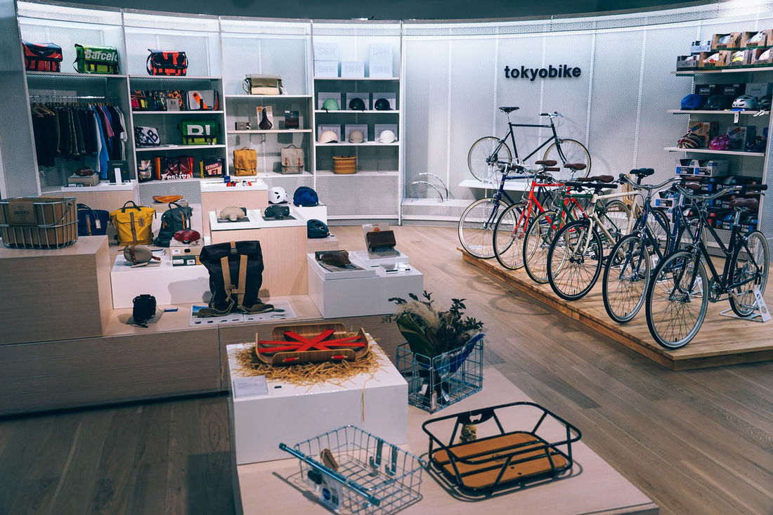 Tokyo bike and other accessories shop in a mall. Business Cycle Economy Goods Market Modern Tokyo Accessories Bicycle Bike Building Buy Design Display Floor Gear Gloves Hall Helmets Indoors  Interior Items Mall Tokyobike Tshirts